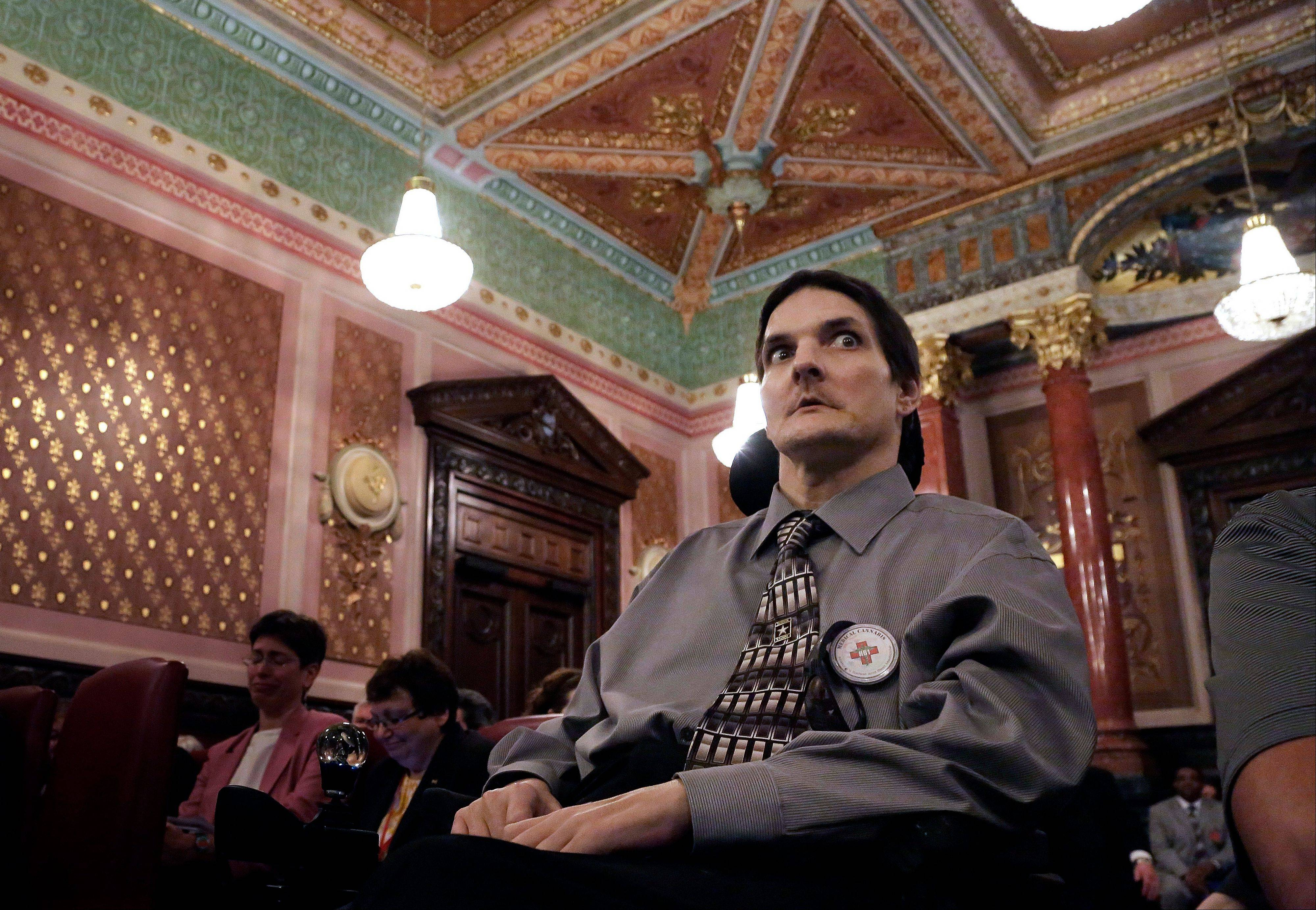 Multiple sclerosis patient Jim Champion listens to lawmakers during a Senate Executive Committee hearing on medical marijuana at the Illinois State Capitol Wednesday.