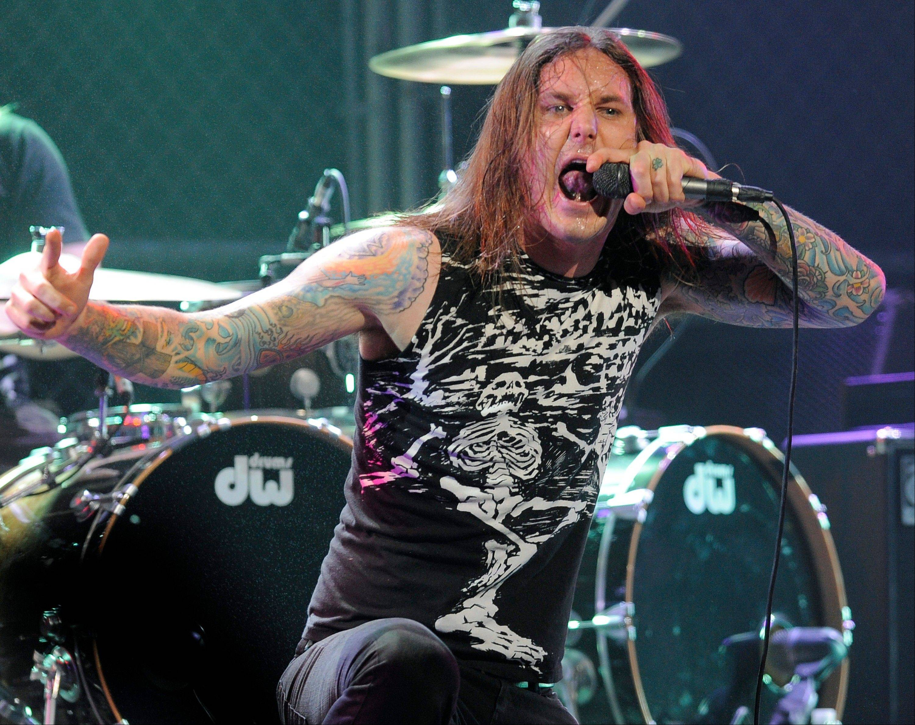 Authorities say Tim Lambesis, the singer of Grammy-nominated heavy metal band As I Lay Dying, was arrested Tuesday in Southern California after trying to hire an undercover detective to kill his estranged wife.