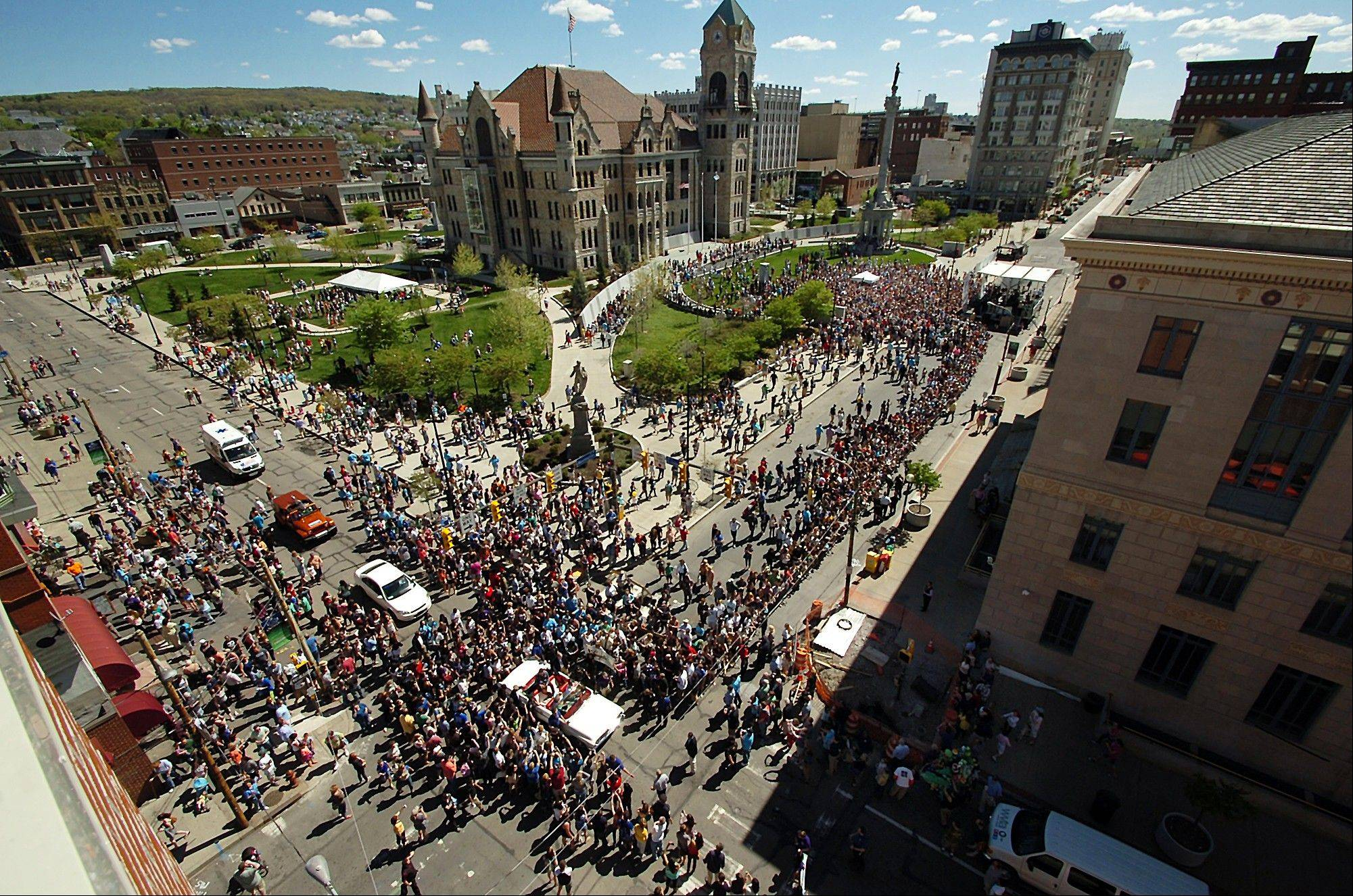 "Thousands of people swarm downtown Scranton, Pa., during ""The Office"" Parade. The actors who play Pam, Jim, Dwight and other beloved characters from the popular NBC show ""The Office"" bade farewell to the northeastern Pennsylvania city of Scranton that served as the TV setting for their fictional paper company."