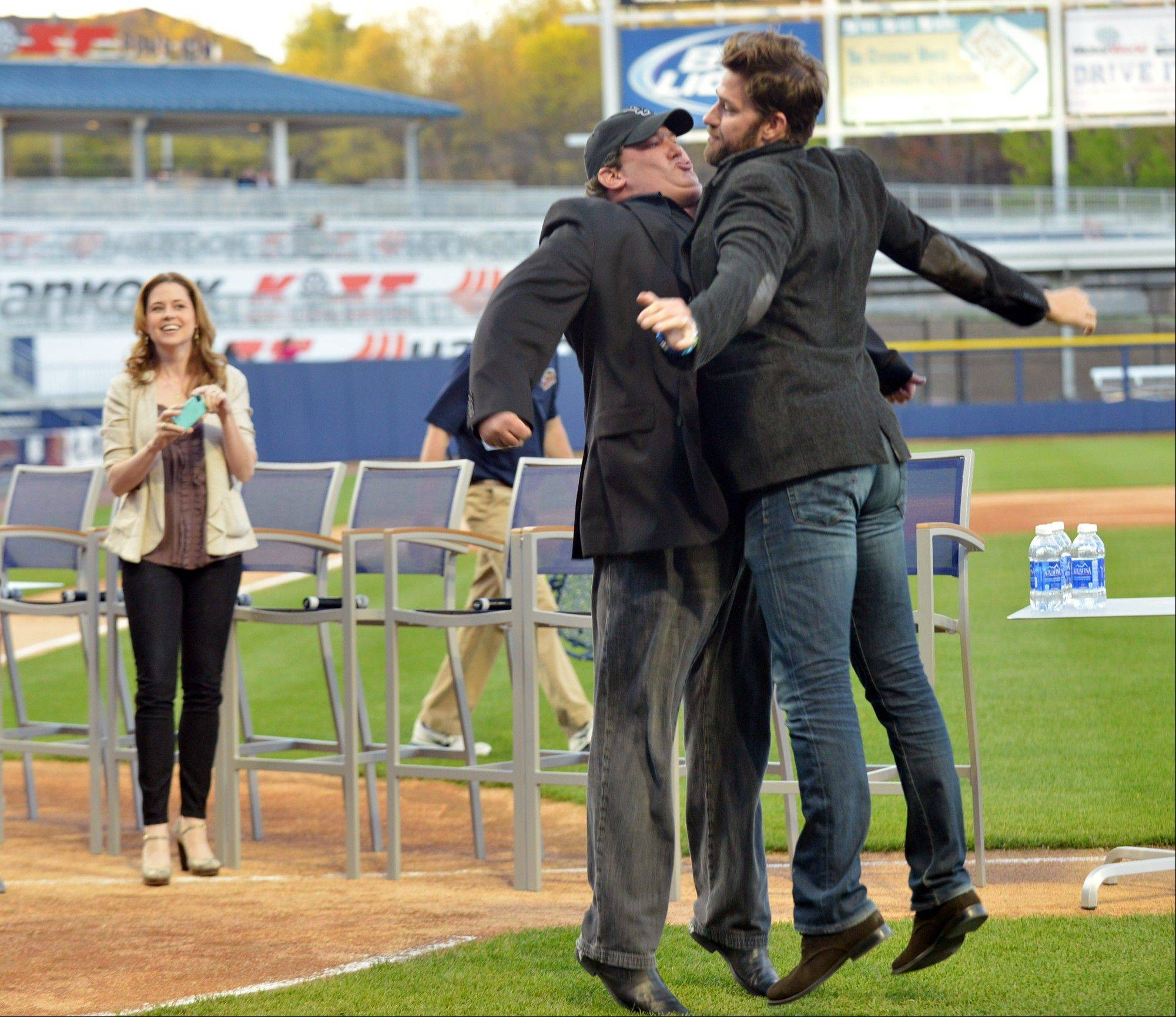 "John Krasinski and Brian Baumgartner, chest bump, as they are introduced during ""The Office"" Wrap Party at PNC Field in Scranton, Pa."