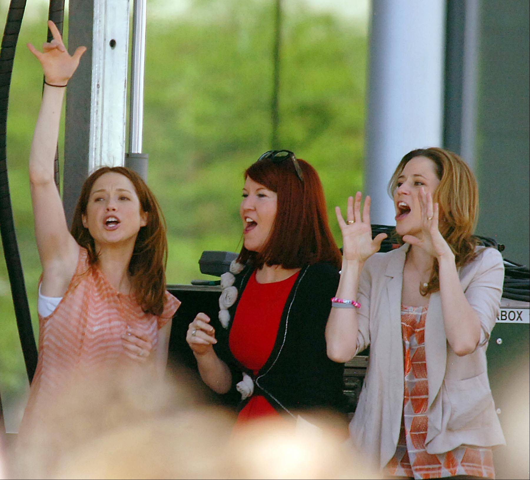 "Actors from ""The Office"" from left: Ellie Kemper, Kate Flannery and Jenna Fischer perform onstage in downtown Scranton."