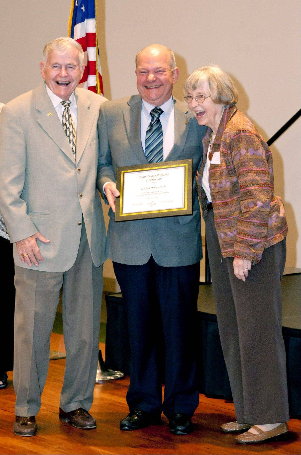 Marlene Shales, pictured accepting an Elgin Image Award with her husband, Jack Shales, left, and Mayor David Kaptain, was given a lifetime achievement award Thursday by Elgin YWCA.