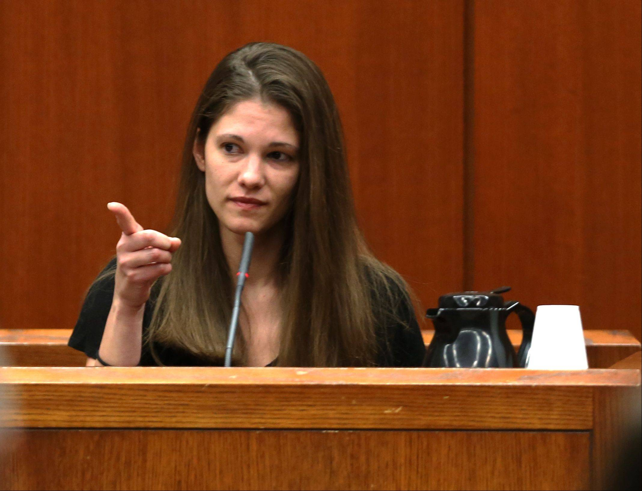 Robin Heinzelman, a former girlfriend of Johnny Borizov, points out Borizov before testifying Thursday at Borizov's triple-murder trial at the DuPage County courthouse in Wheaton.