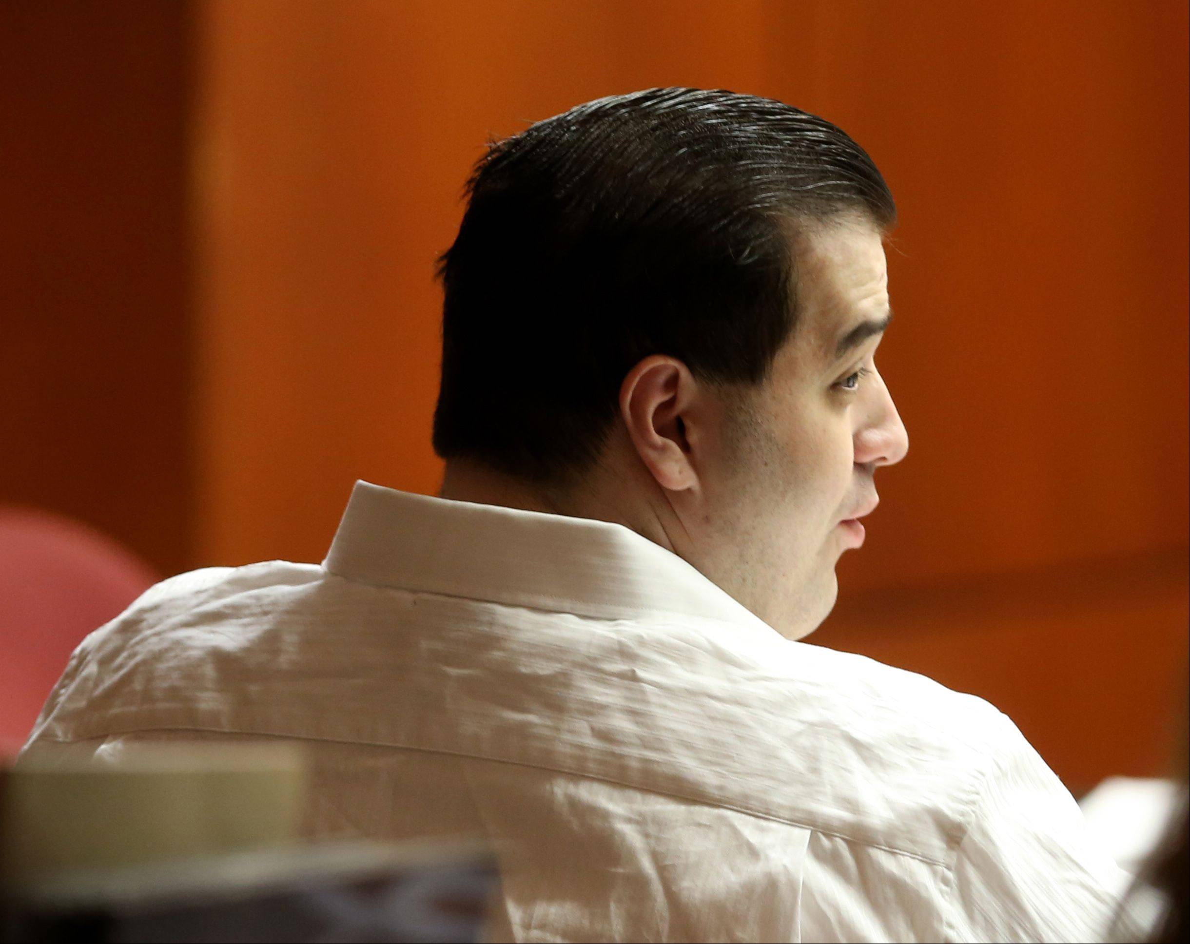 Triple-murder suspect Johnny Borizov listens to testimony Thursday at his trial in Wheaton.