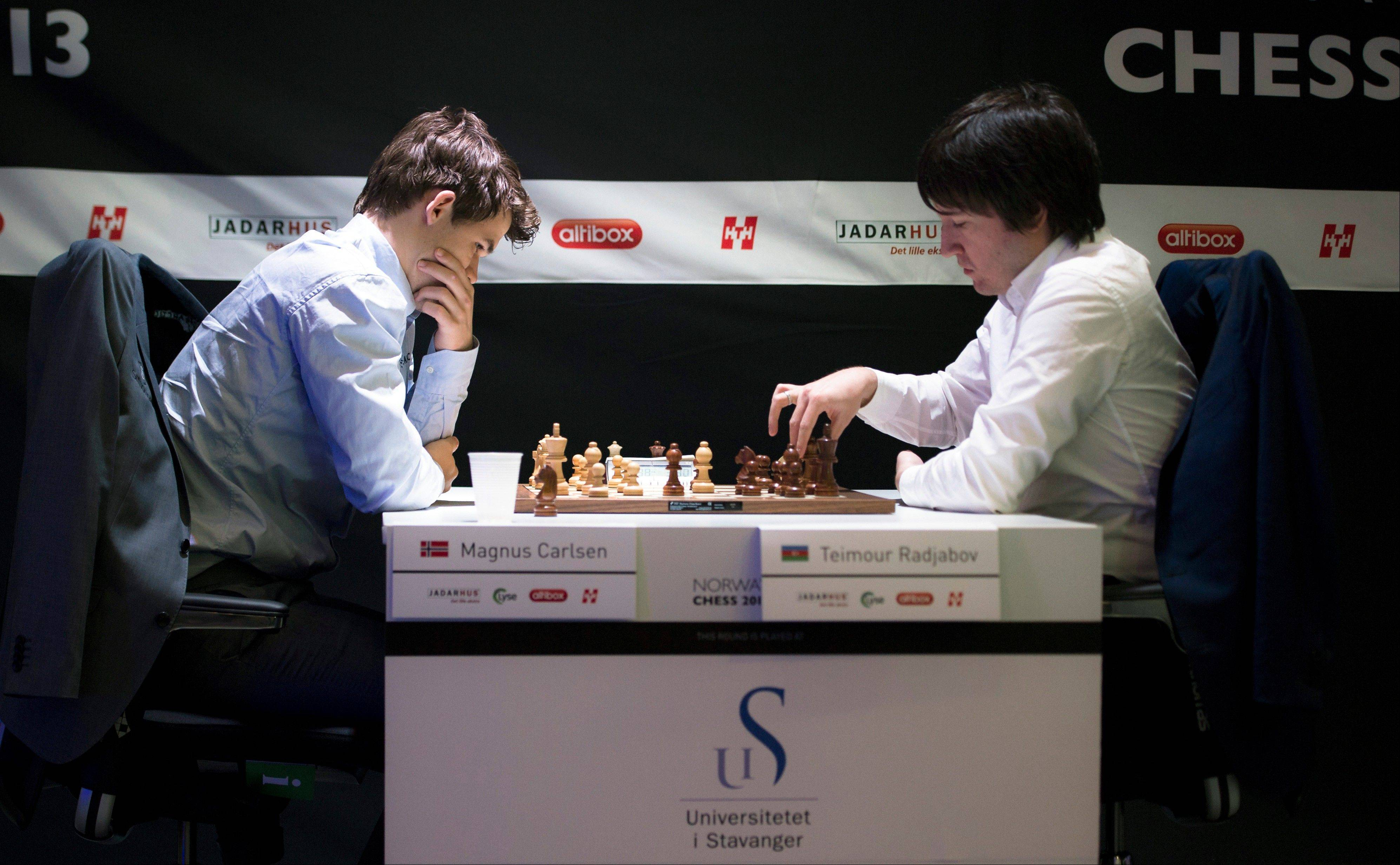 Norway's Magnus Carlsen, left, plays Tuesday against Azerbaijan's Teimour Radjabov during the Norway Chess competition 2013 in Sandnes near Stavanger, Norway.
