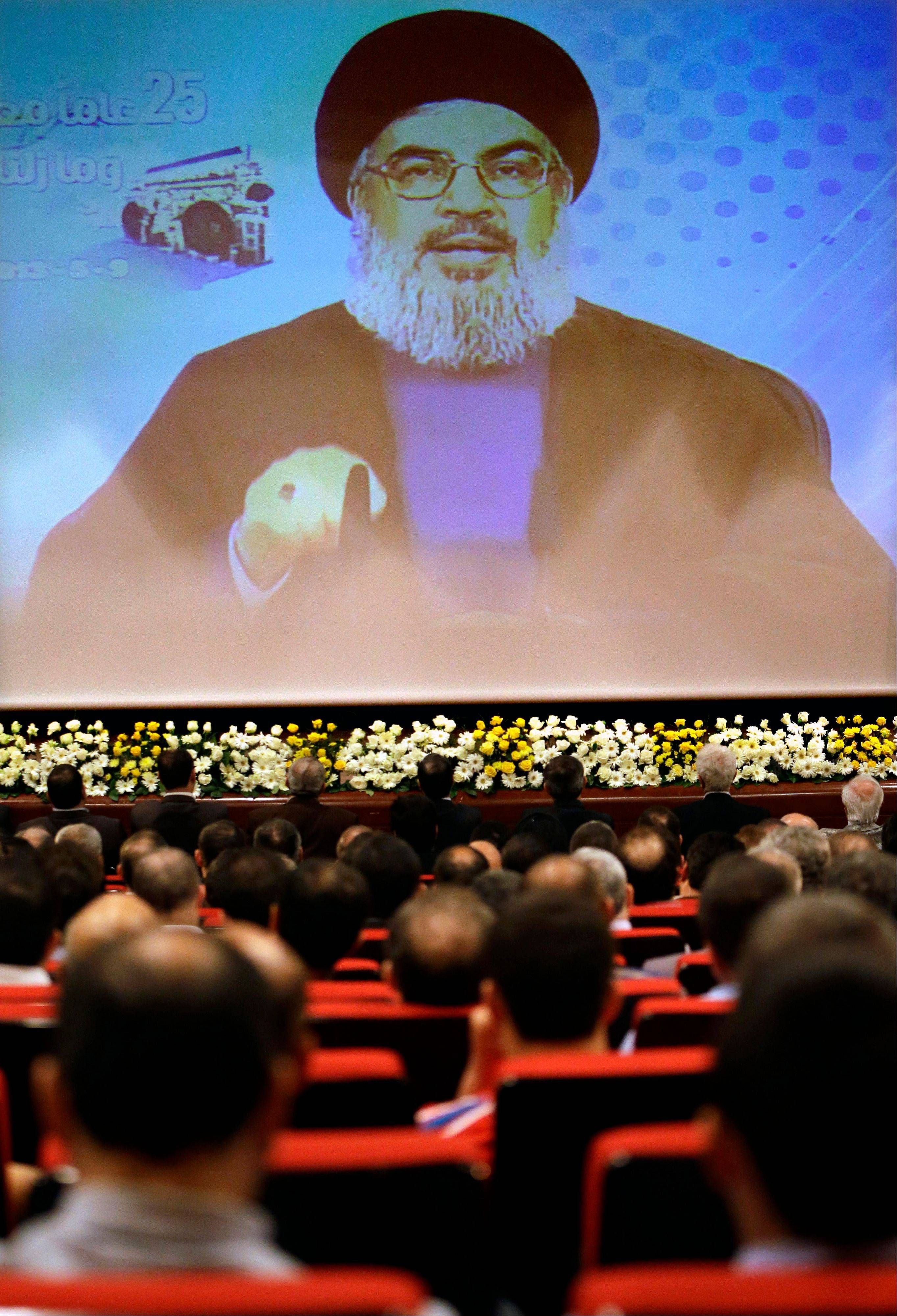 Hezbollah leader Sheik Hassan Nasrallah speaks Thursday via video during a conference, held in a southern suburb of Beirut, Lebanon.