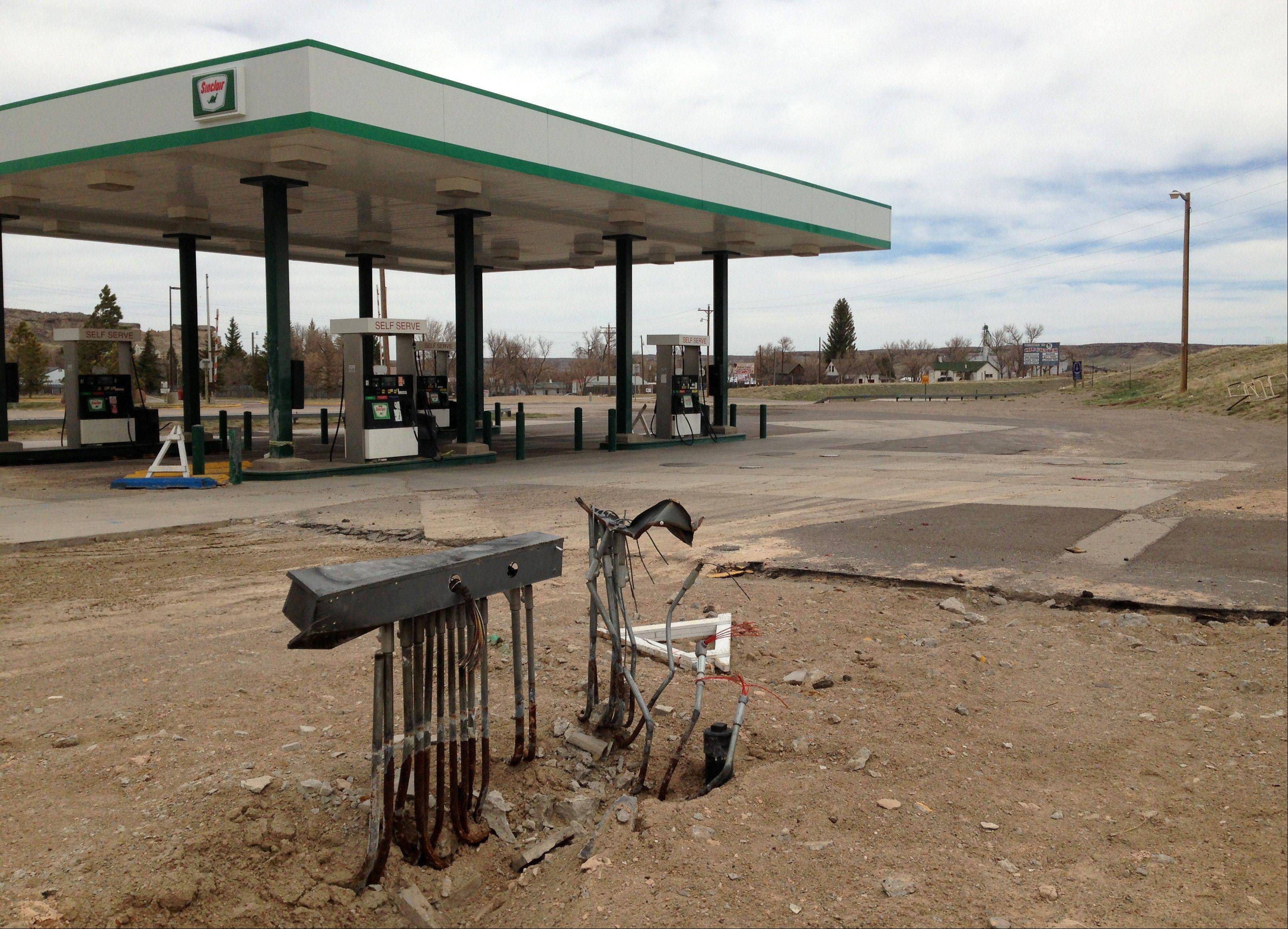 All that remains of the Horton's Corner convenience store, foreground in Chugwater, Wyo., after a Dec. 30, 2012 fire caused by a sport utility vehicle that crashed into the store. Horton's Corner was the only place for miles around to get gas or groceries and may not be rebuilt for several months yet.