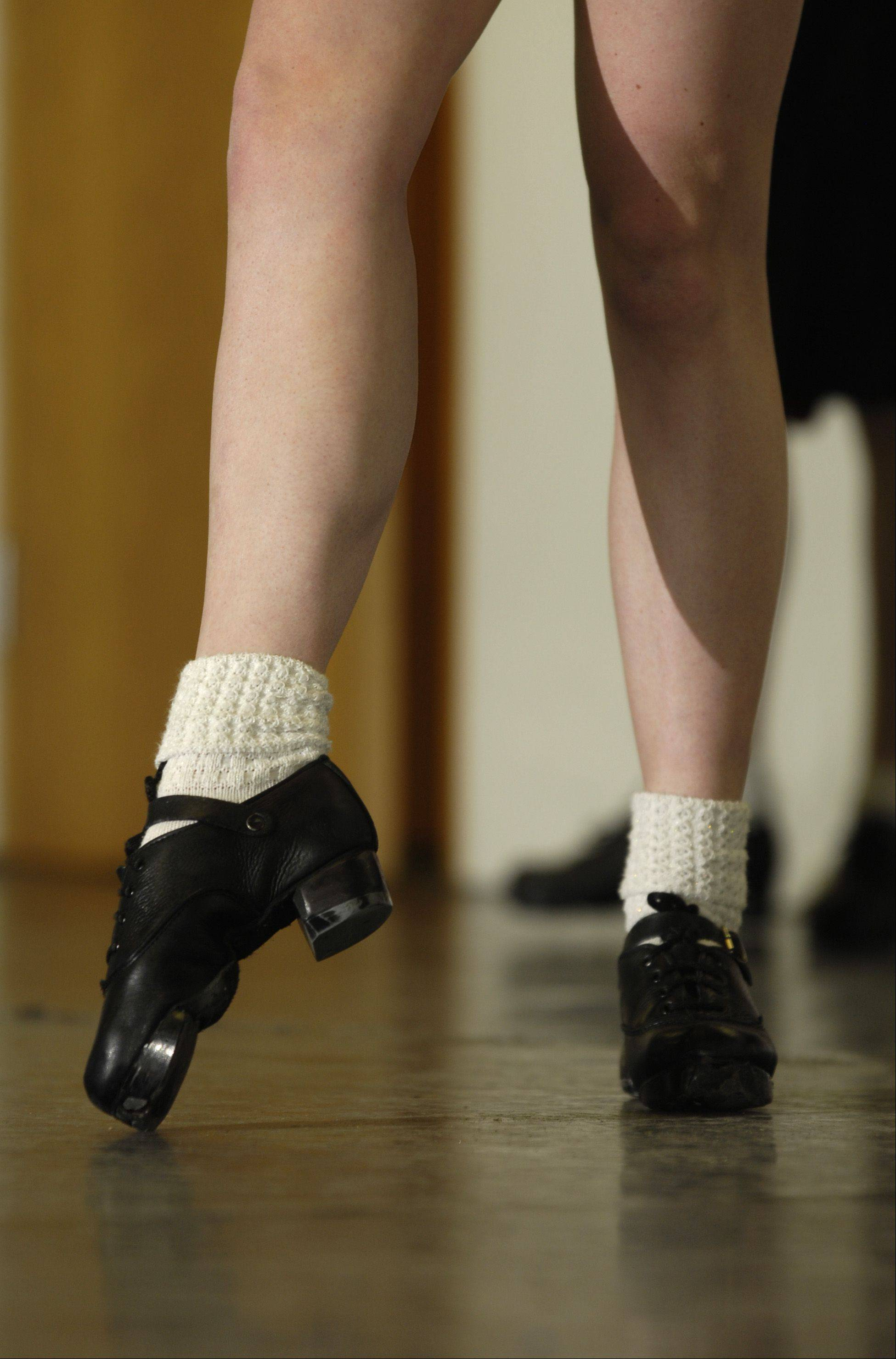 Irish dancer Moira Kramp taps, stomps and clicks her feet as accordion and fiddle players start their jig.
