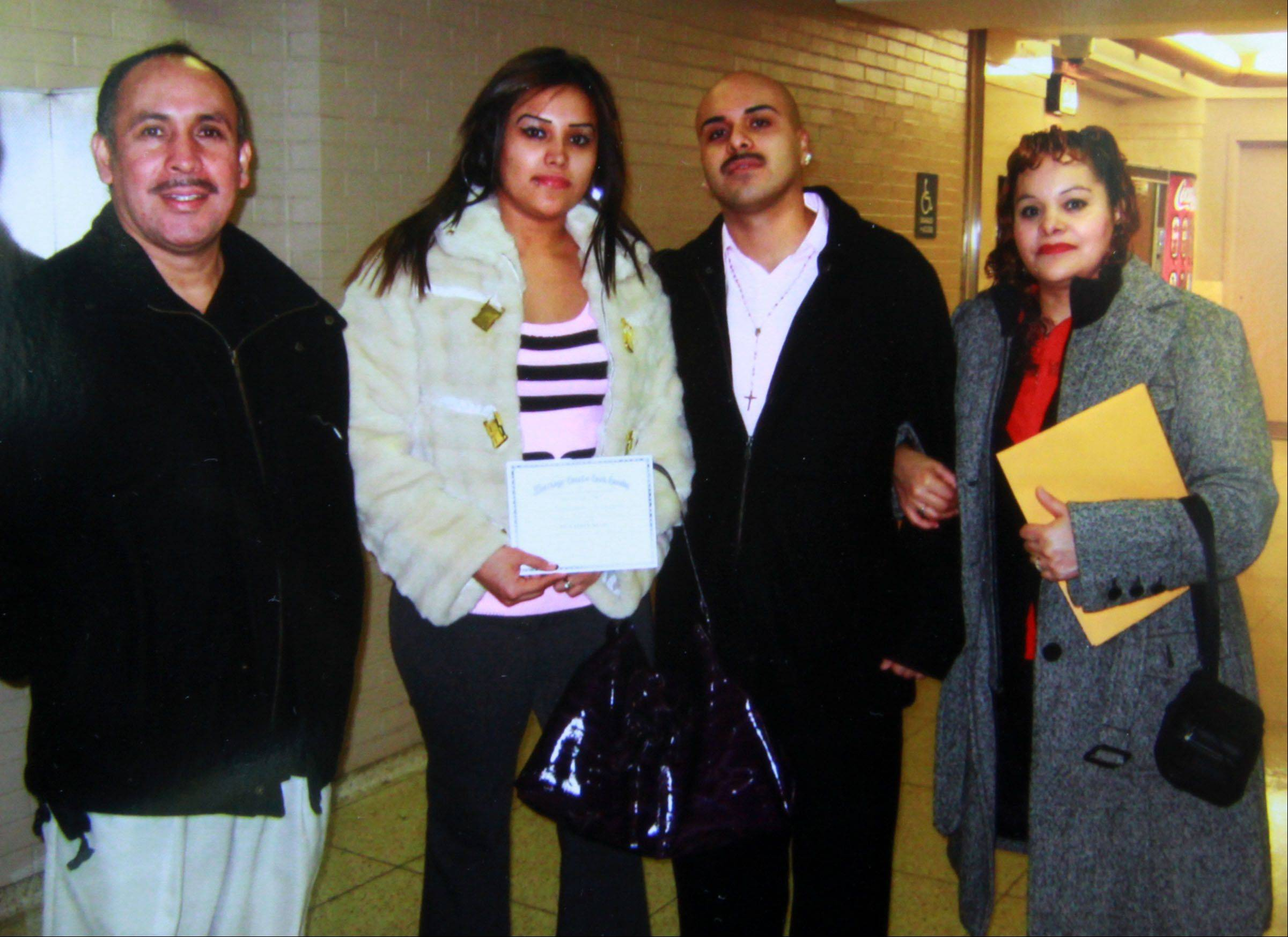 At their 2011 wedding, Rafael Orozco and Mayra Ceniceros, center, celebrate with Orozco's parents, Rafael and Irma Orozco. The younger Orozco was killed May 1 in Wheeling when he was shot in the back by a stray bullet.