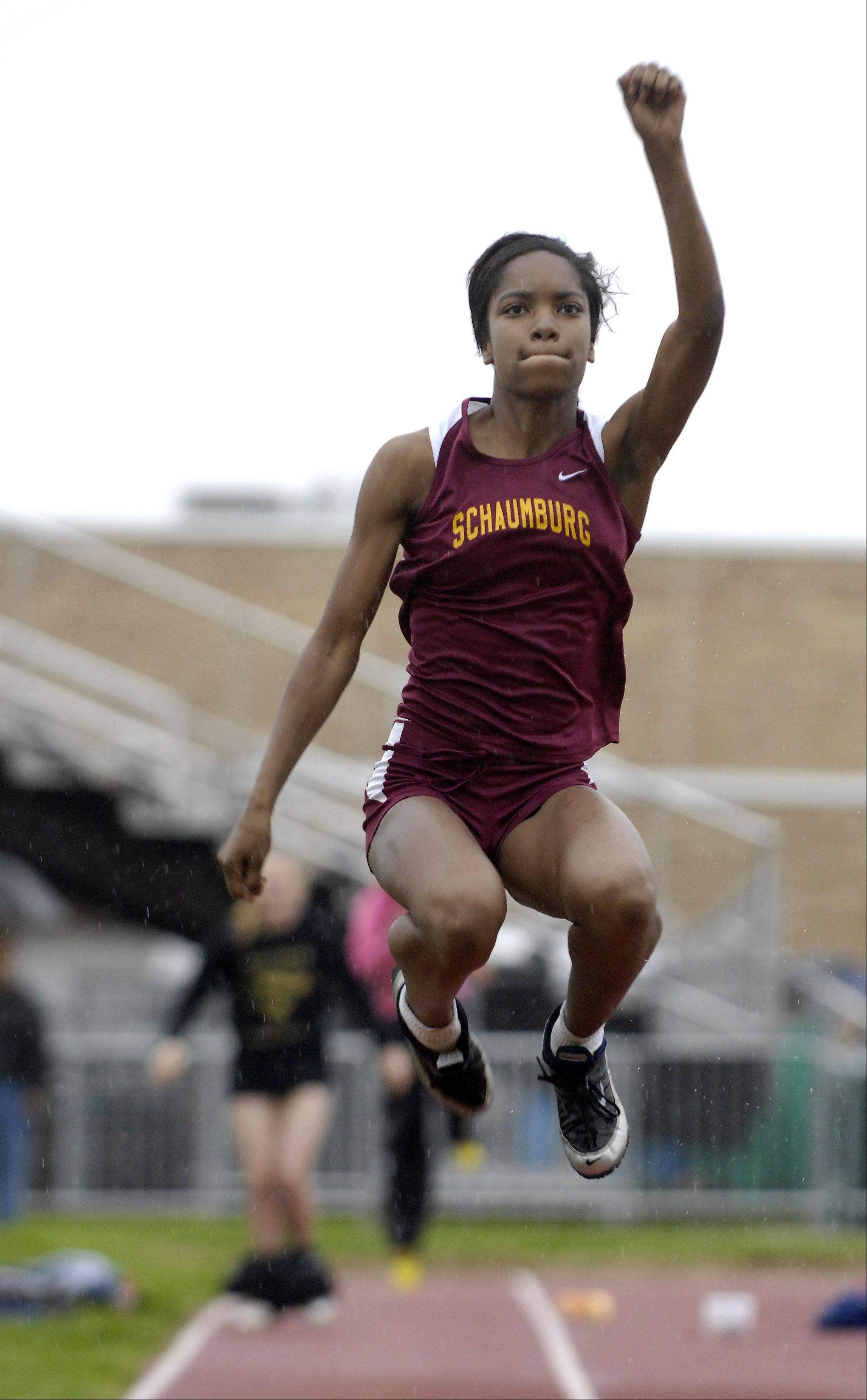 Rick West/rwest@dailyherald.comEnfiniti Kelly of Schaumburg competes in the long jump during the West Aurora girl's track sectional Thursday.