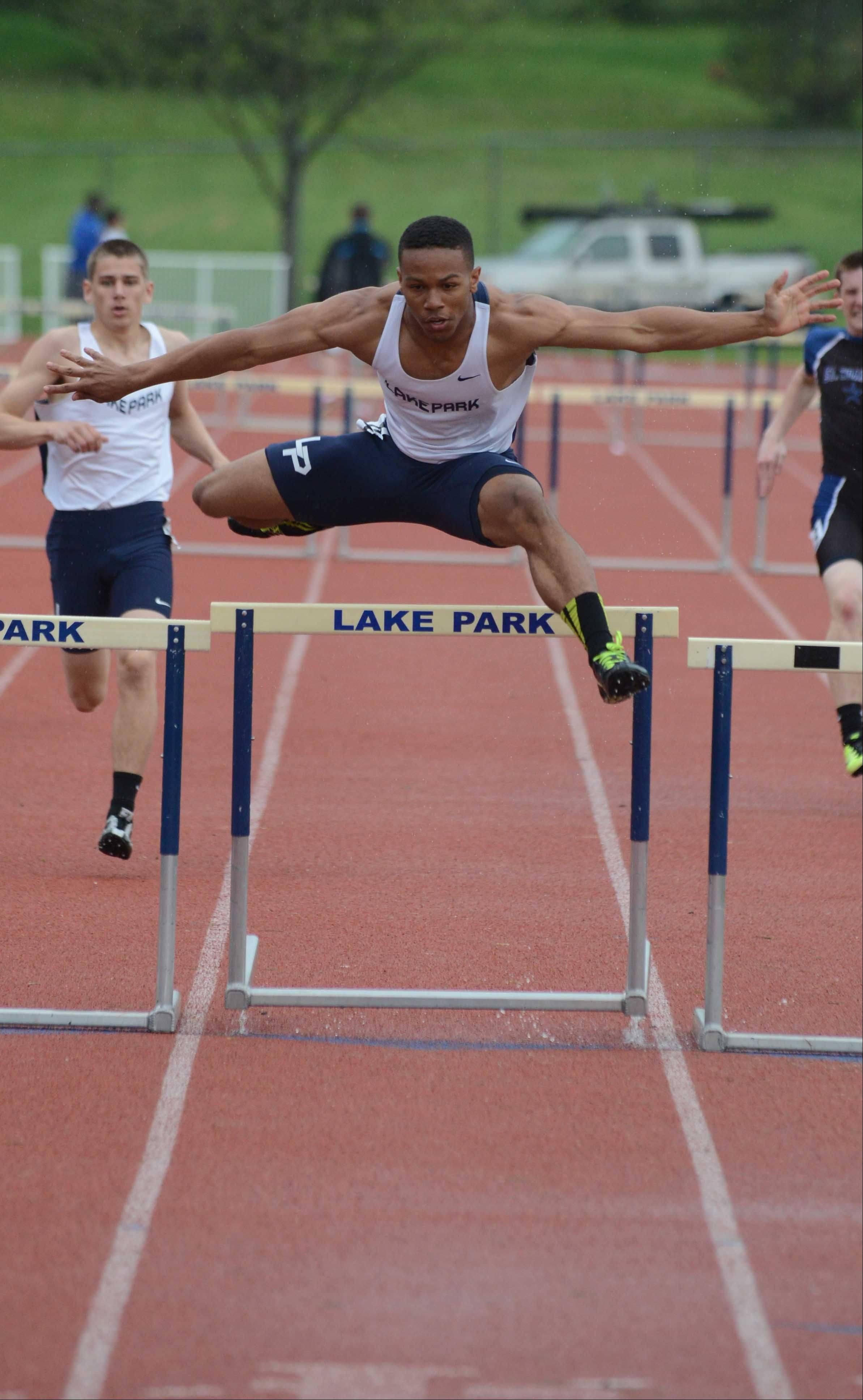 Antonio Shenault of Lake Park takes part in the 300 meter hurdles during the Upstate Eight Conference boys track finals Thursday.The event was held at Lake Park East Campus.