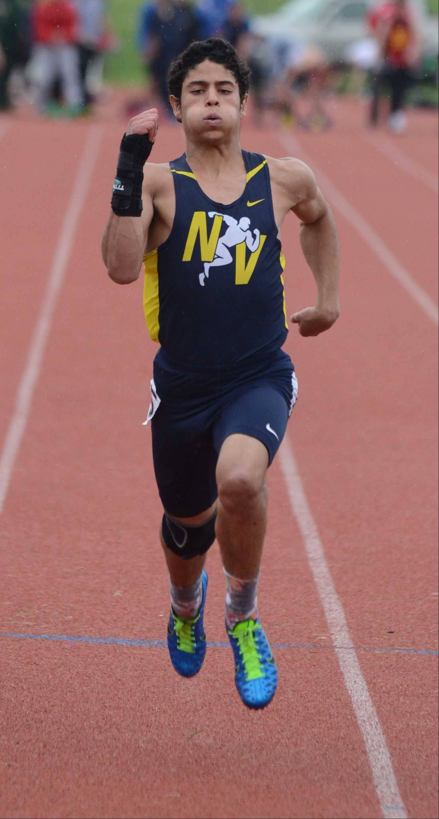Christopher Malave of Neuqua Valley ran the 100 meter dash during the Upstate Eight Conference boys track finals Thursday. The event was held at Lake Park East Campus.