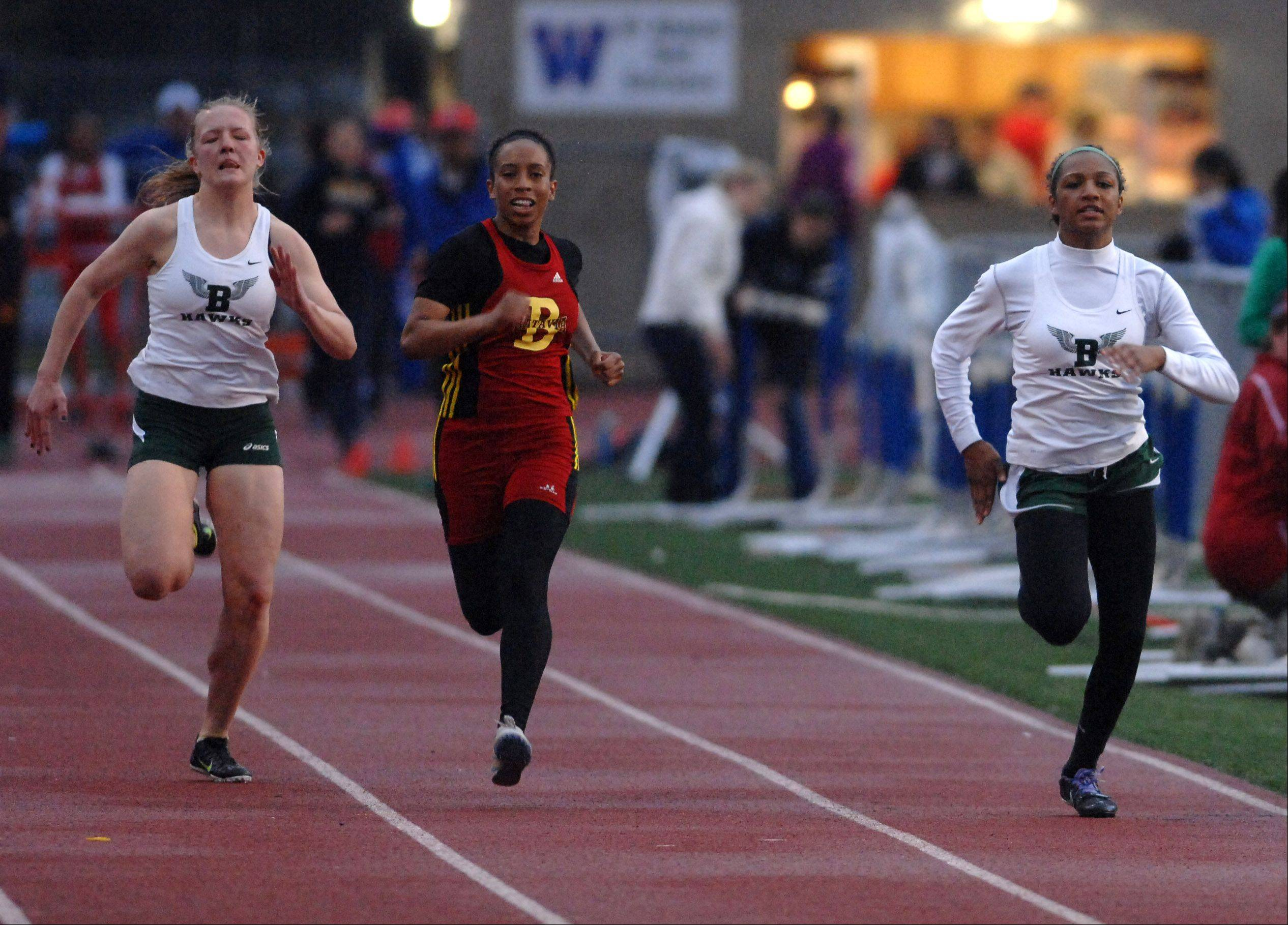 Candace Trent of Bartlett, right, finished third in the 100-meter dash during the West Aurora girl's track sectional Thursday. Megan Seidl of Bartlett and Chanelle Gibson of Batavia are running at left.