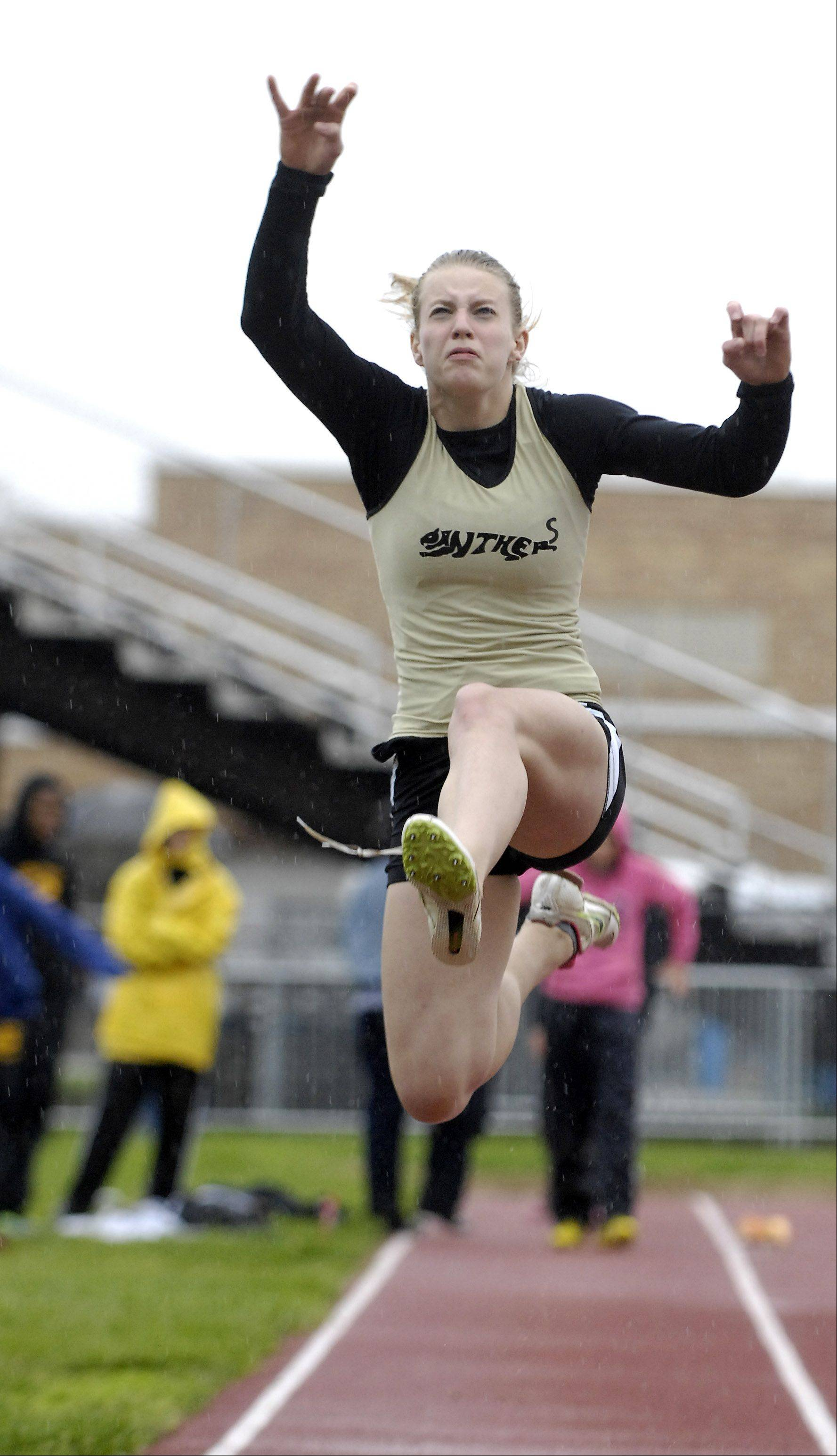 Allison Wahrman of Glenbard North competes in the long jump during the West Aurora girl's track sectional Thursday.