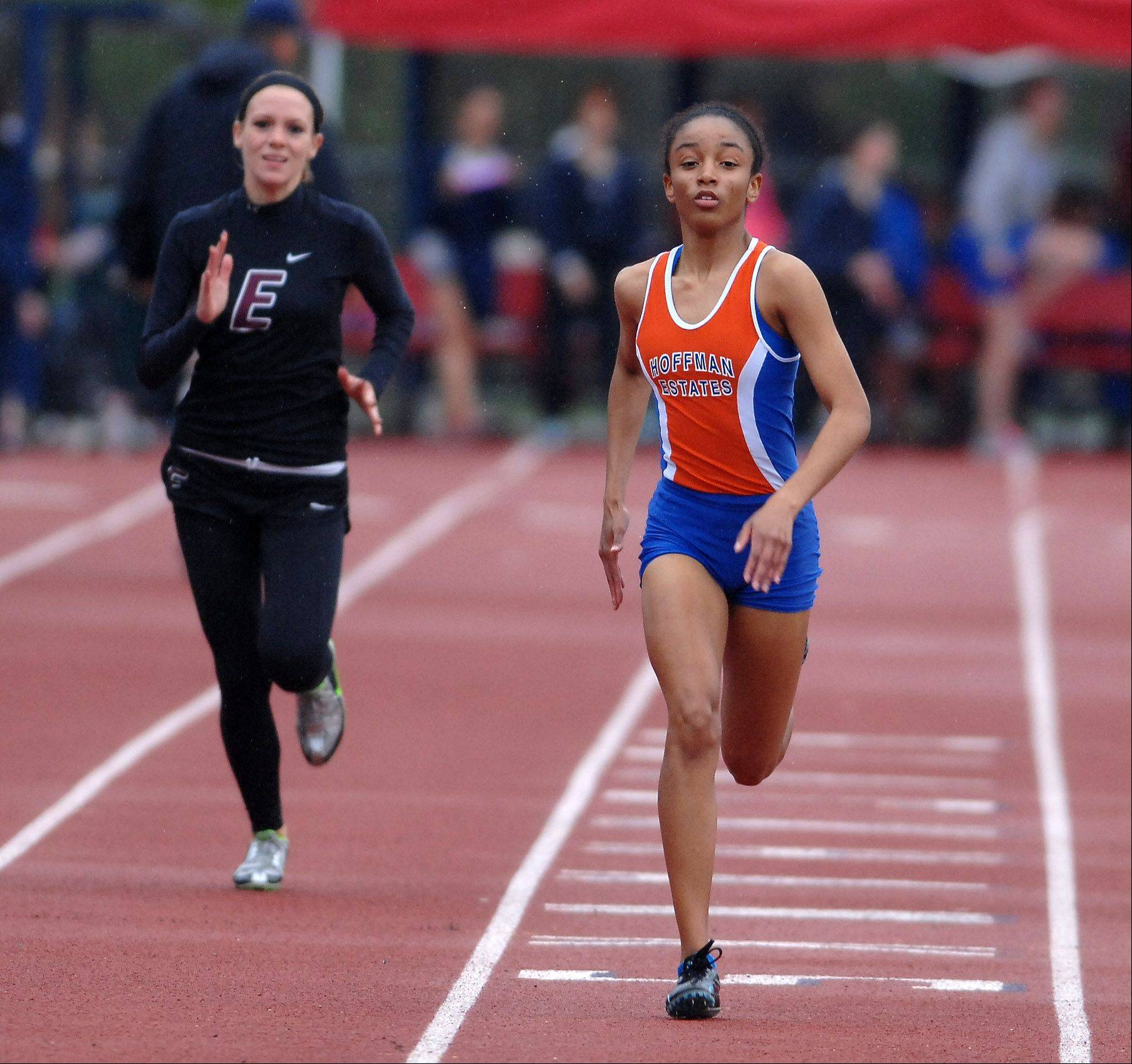 Kaylan Williams of Hoffman Estates wins her preliminary heat of the 200 meter dash during the West Aurora girl's track sectional Thursday.