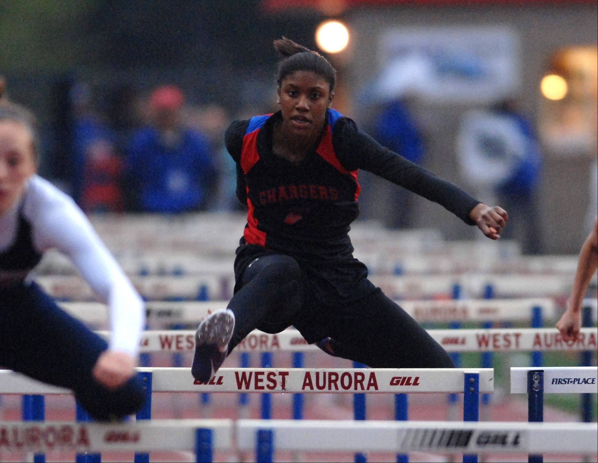 Kayla Lawrence of Dundee-Crown runs in the finals of the 100-meter hurdles during the West Aurora girl's track sectional Thursday.