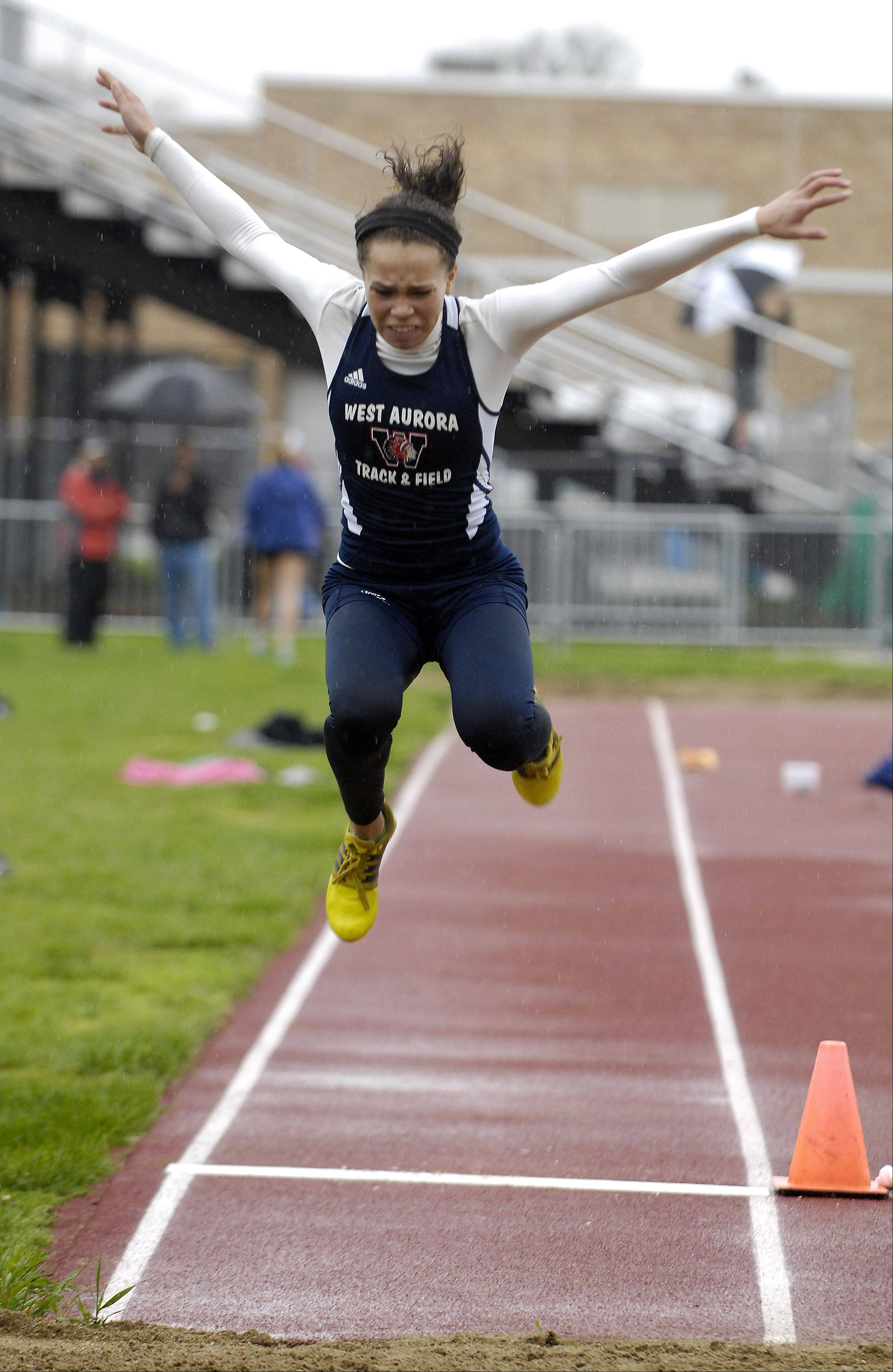 Kyla Walton of West Aurora competes in the long jump during the West Aurora girl's track sectional Thursday.