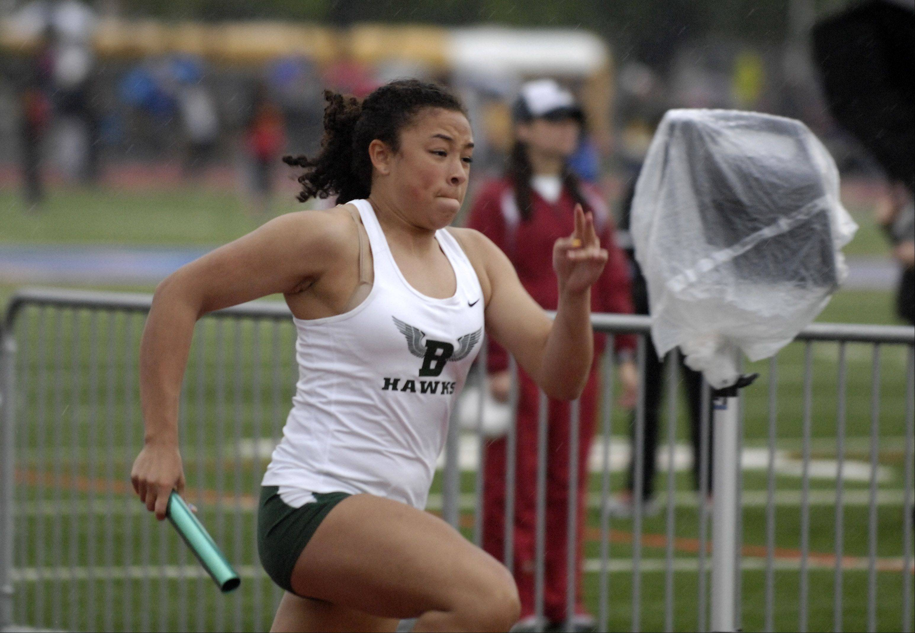 Joslyn Diaz of Bartlett runs the opening leg of the 400-meter relay during the West Aurora girl's track sectional Thursday.