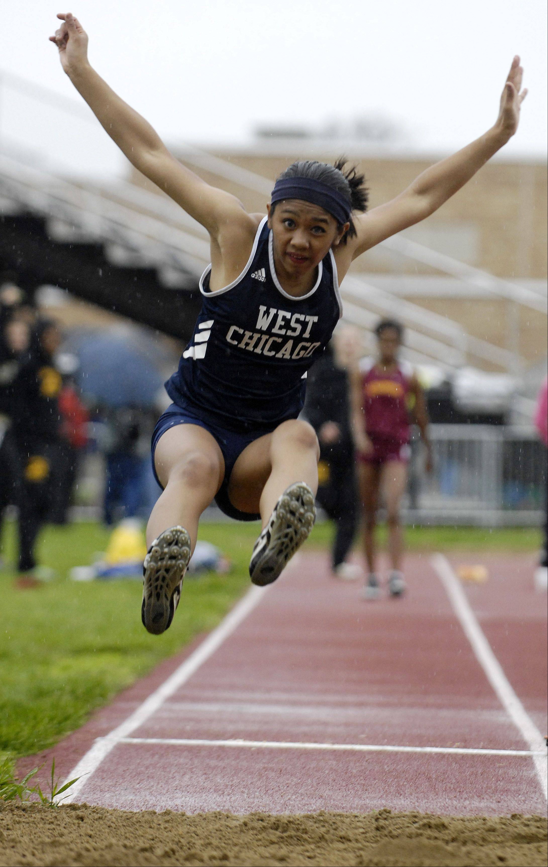 Carla Dannug of West Chicago competes in the long jump during the West Aurora girl's track sectional Thursday.