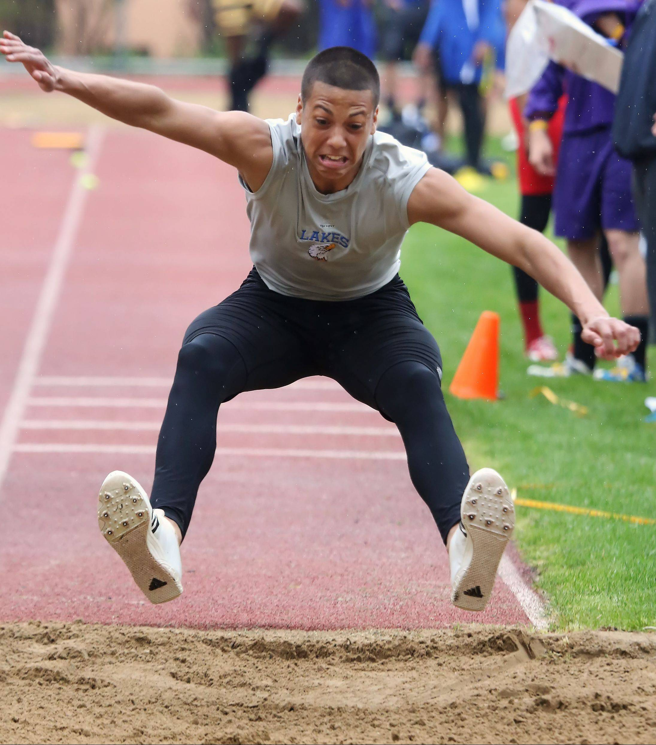 Lakes' Caleb Arnwine competes in the triple jump during the North Suburban Conference boys track meet Thursday at Libertyville High School