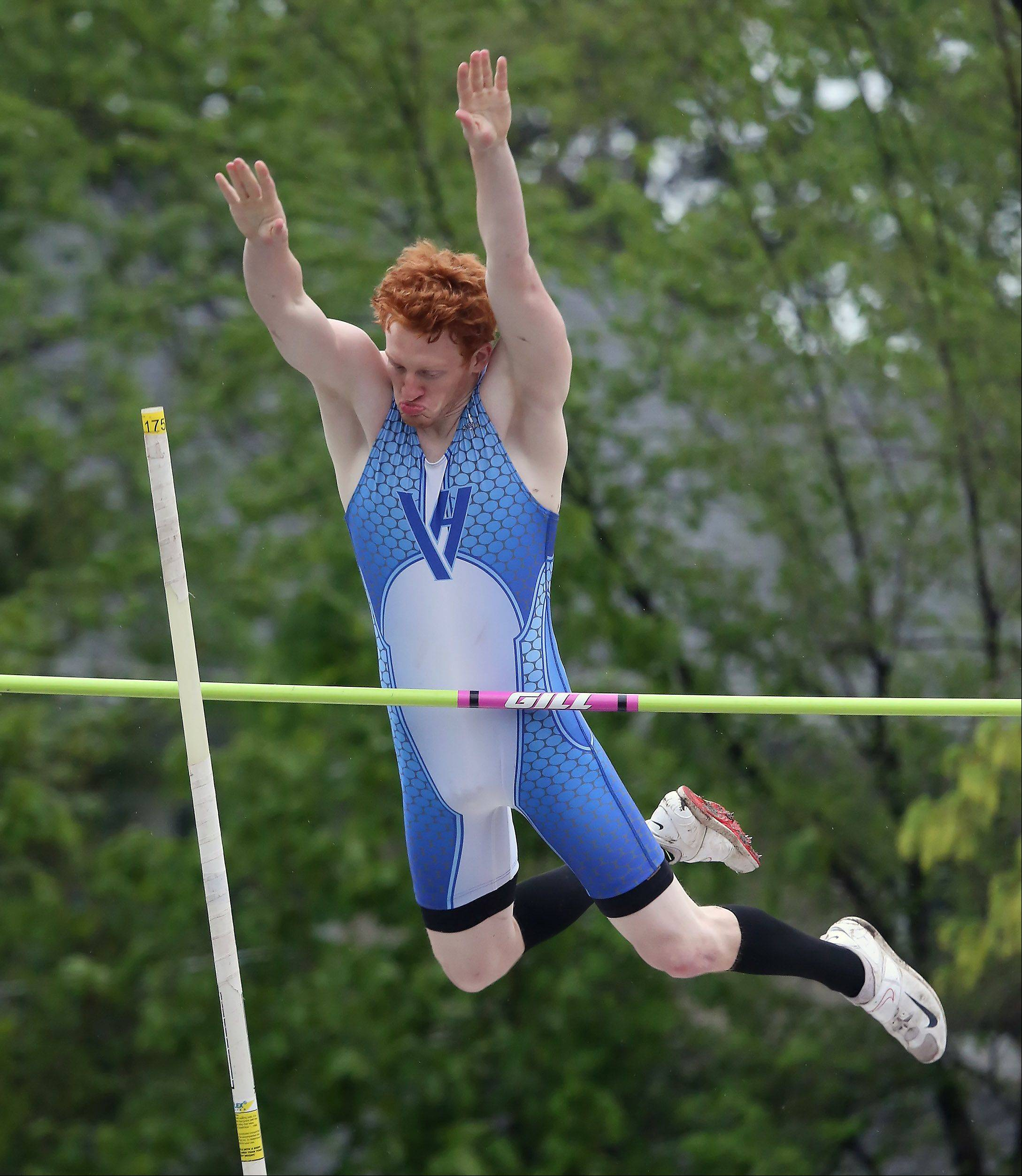 Vernon Hills pole vaulter Nick Foley clears the bar during the North Suburban Conference boys track meet Thursday at Libertyville High School.