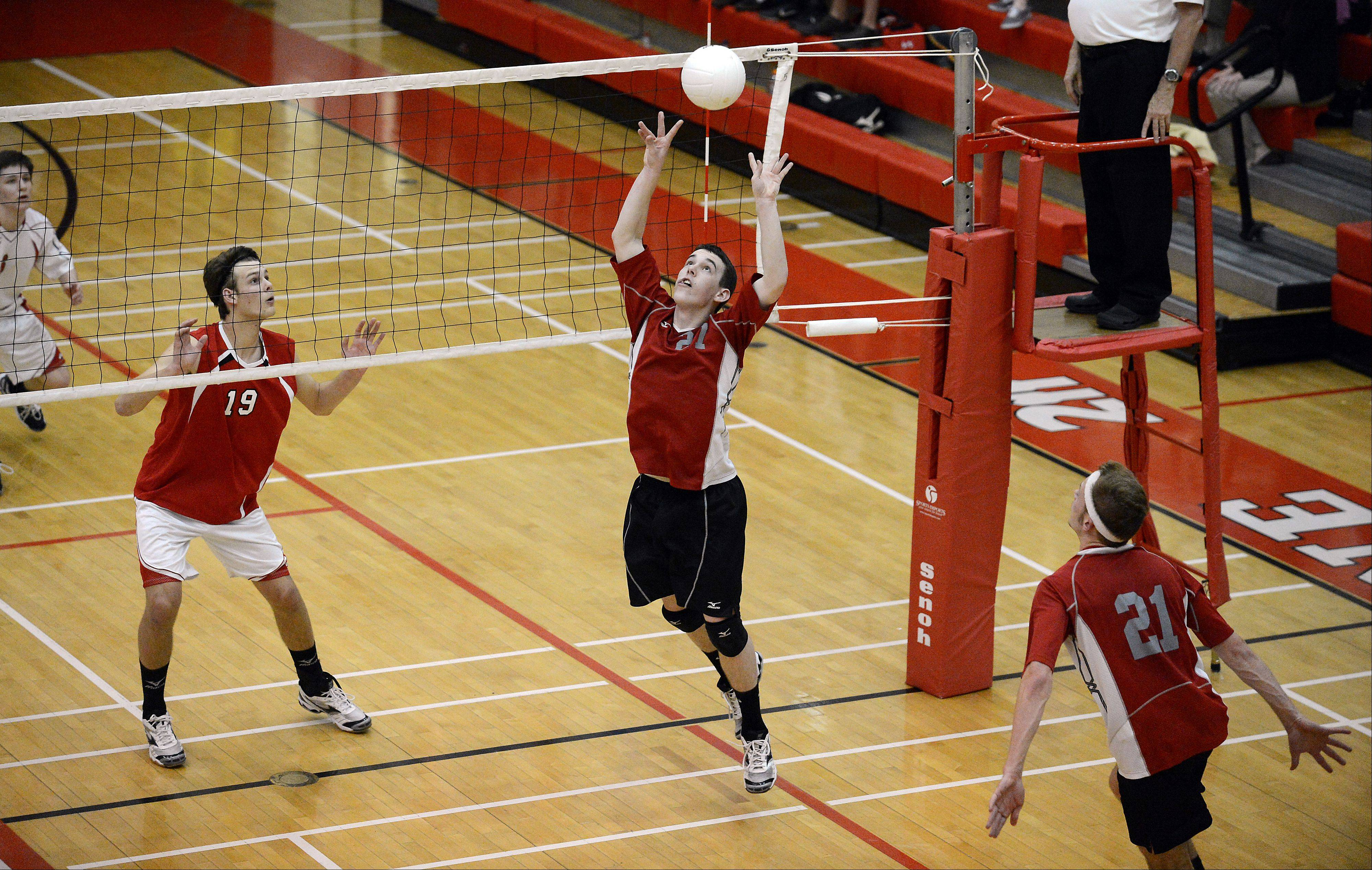 Palatine's Kyle Obernesser sets up the winning point for teammate Jacob Niedzwicki, who attacks past Barrington's Justin Glader for the winning point Thursday against visiting Barrington.