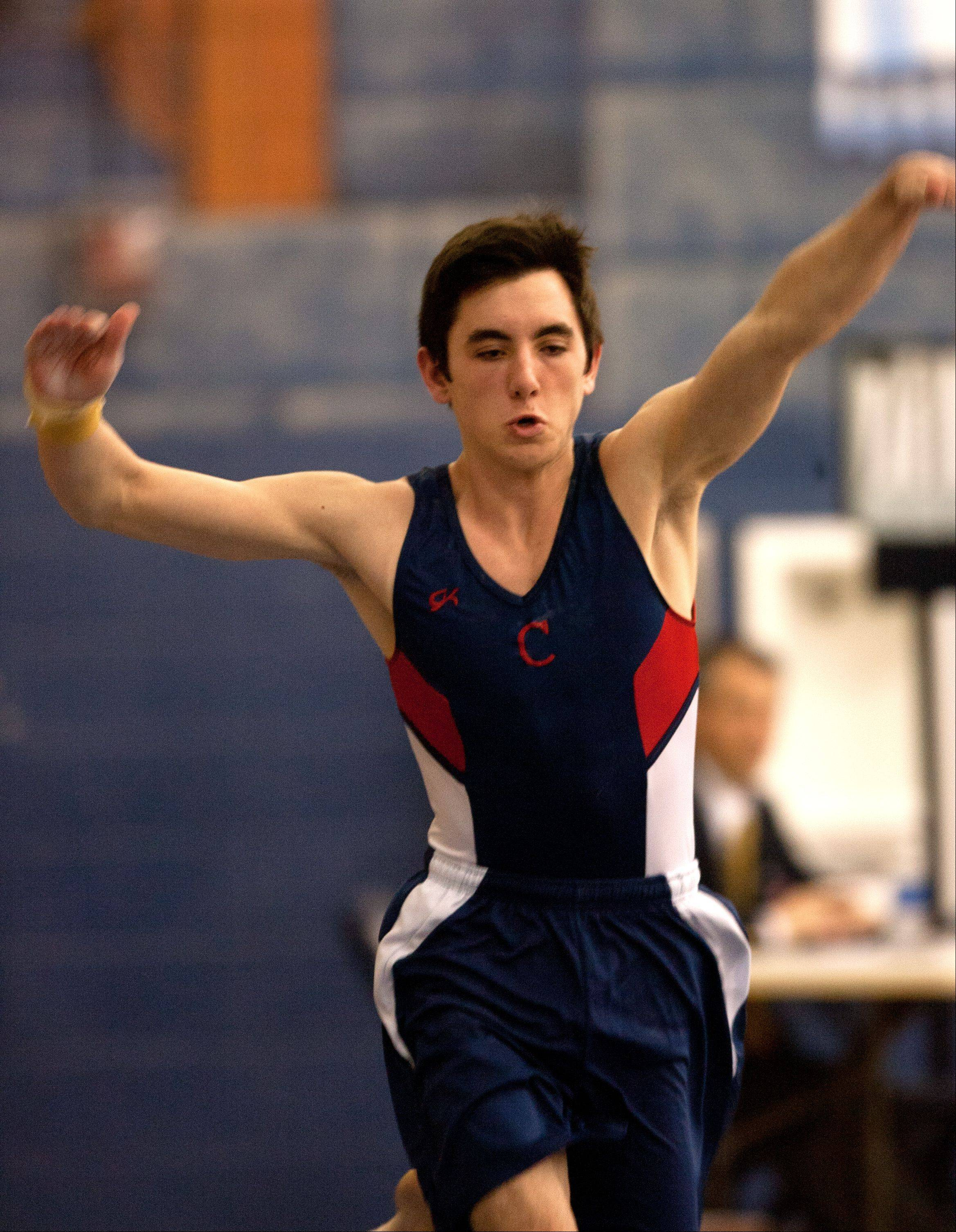 Conant's Brian Reedy performs his floor excercise routine during Ralph Krupke Invitational at Lake Park in March.
