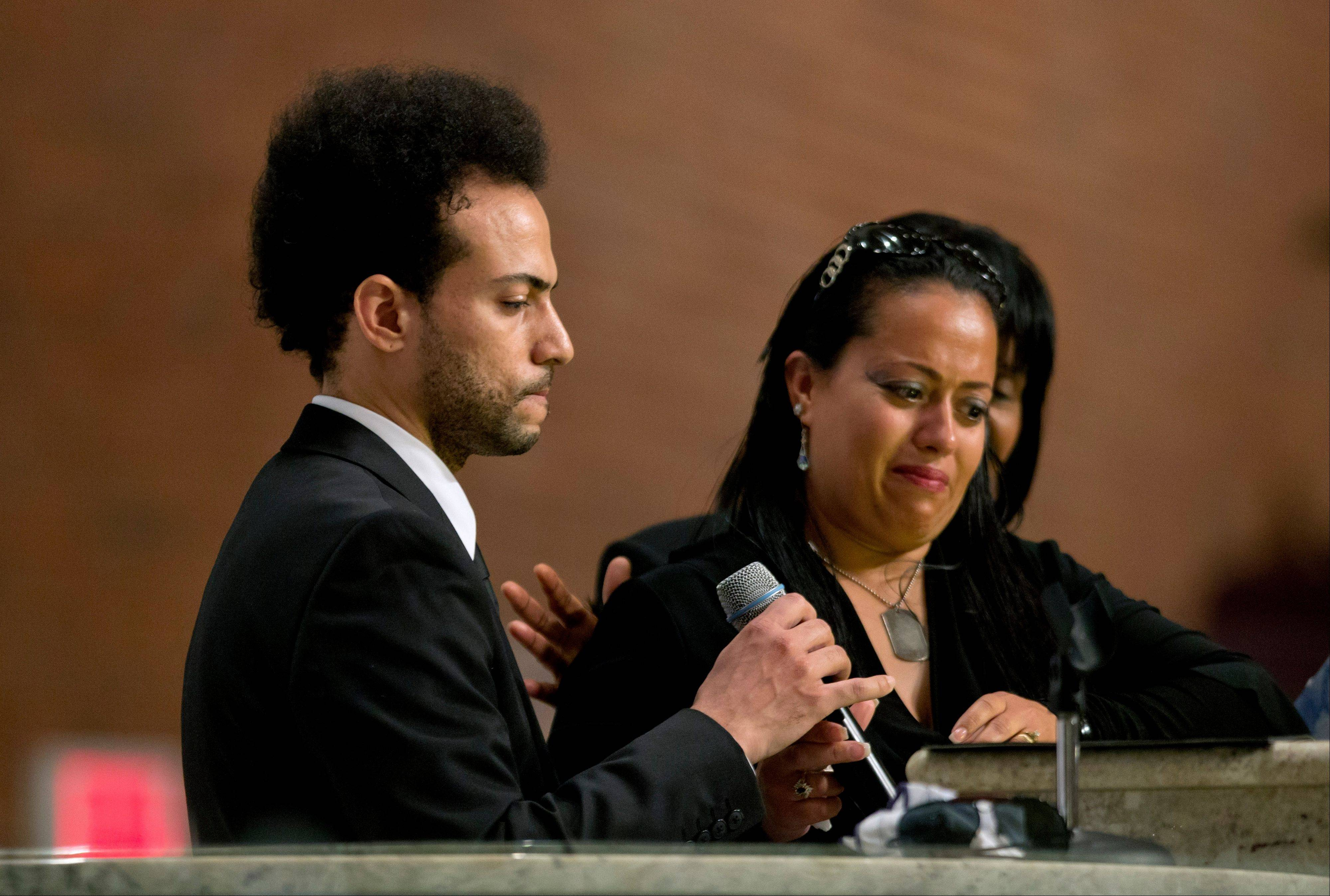 Chris Smith, left, of the rap duo Kris Kross, speaks at the funeral service of fellow band member Chris Kelly, as Smith�s sister, Jennifer Smith, right, listens, Thursday in Atlanta. The 34-year-old Kelly was found dead May 1 of a suspected drug overdose.
