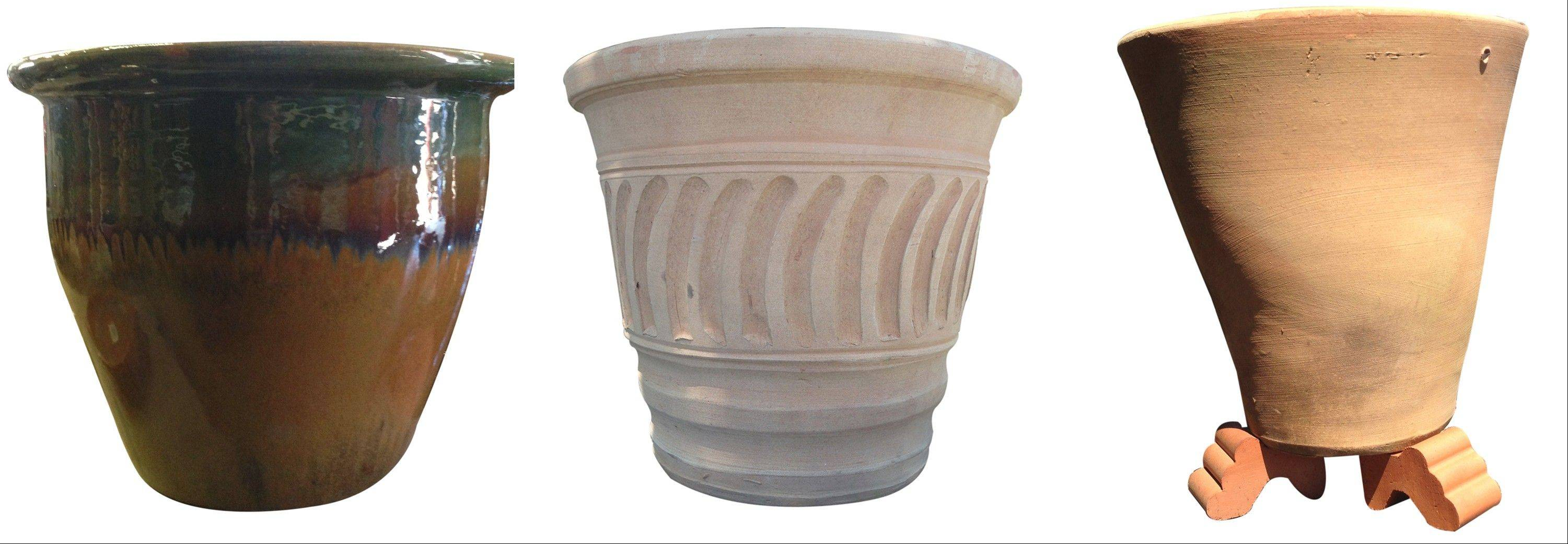 From left, a Savannah Brown ceramic pot; a fluted terra cotta pot, and a pot with clay �feet� which can aid drainage, especially when pots sit directly on paving.