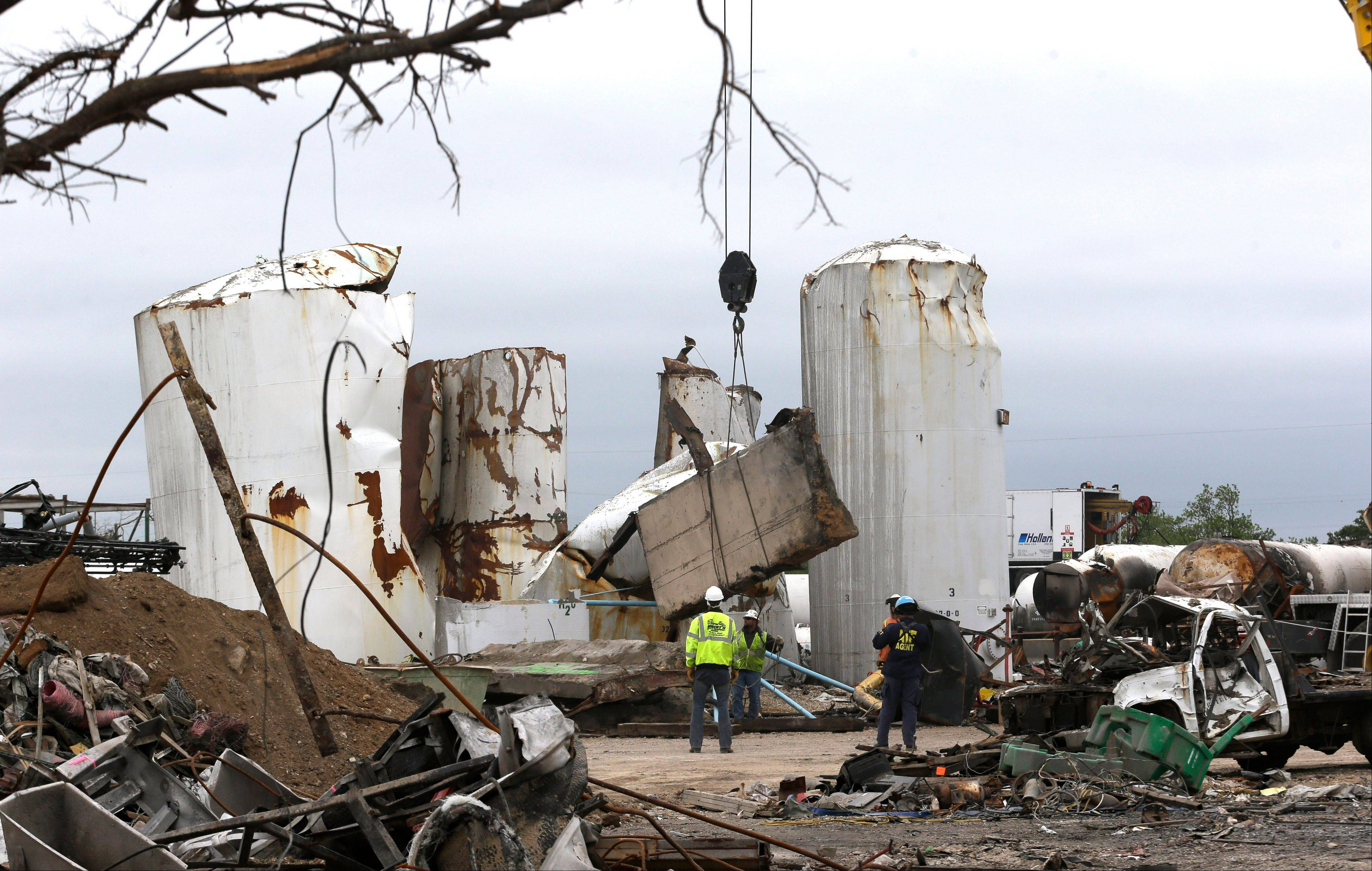 Associated Press/May 2 Investigators move and look through the debris of the destroyed fertilizer plant in West, Texas.