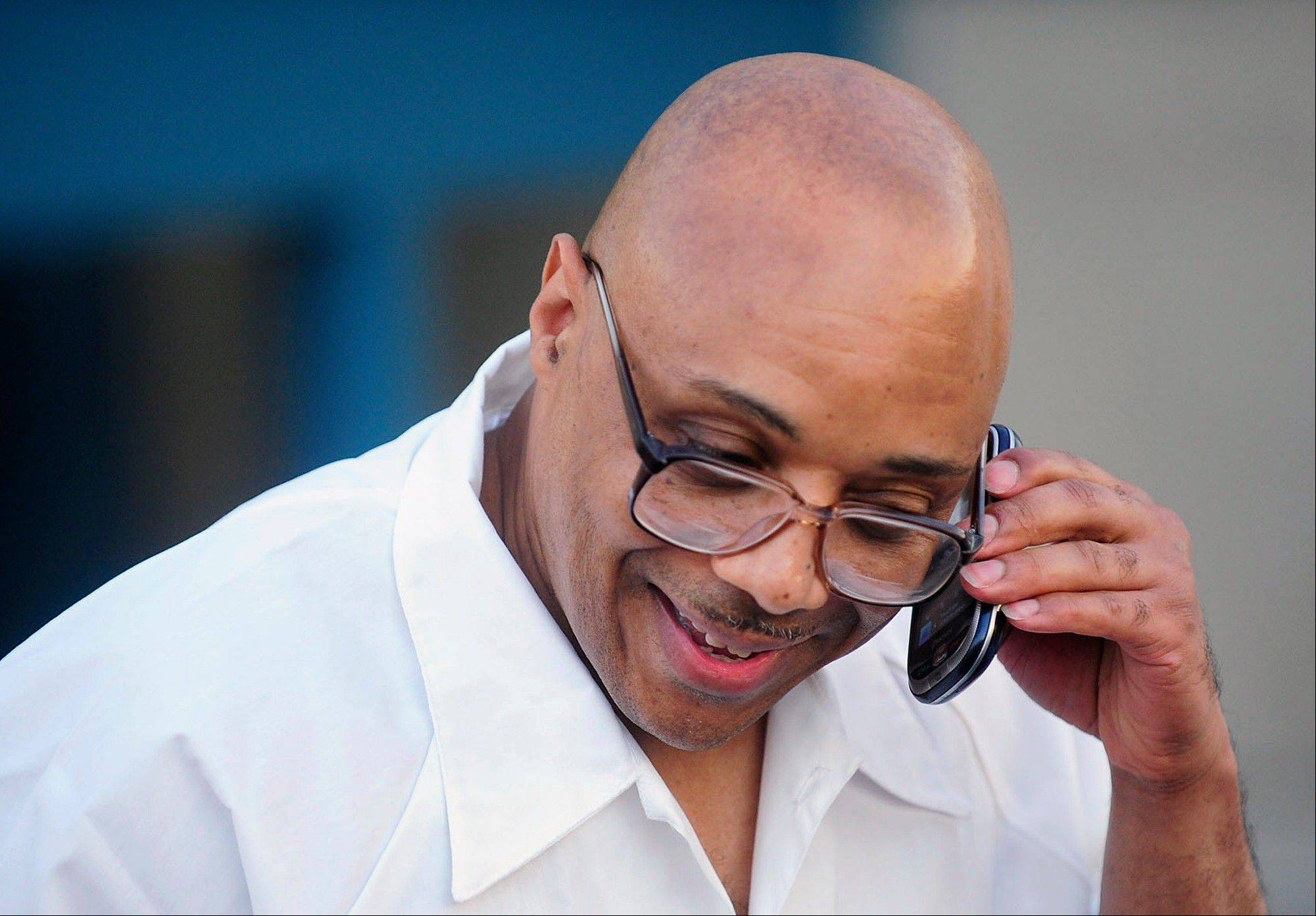 Andre Davis speaks with his mother on a cellphone outside the Tamms Correctional Center after being released from prison last summer.
