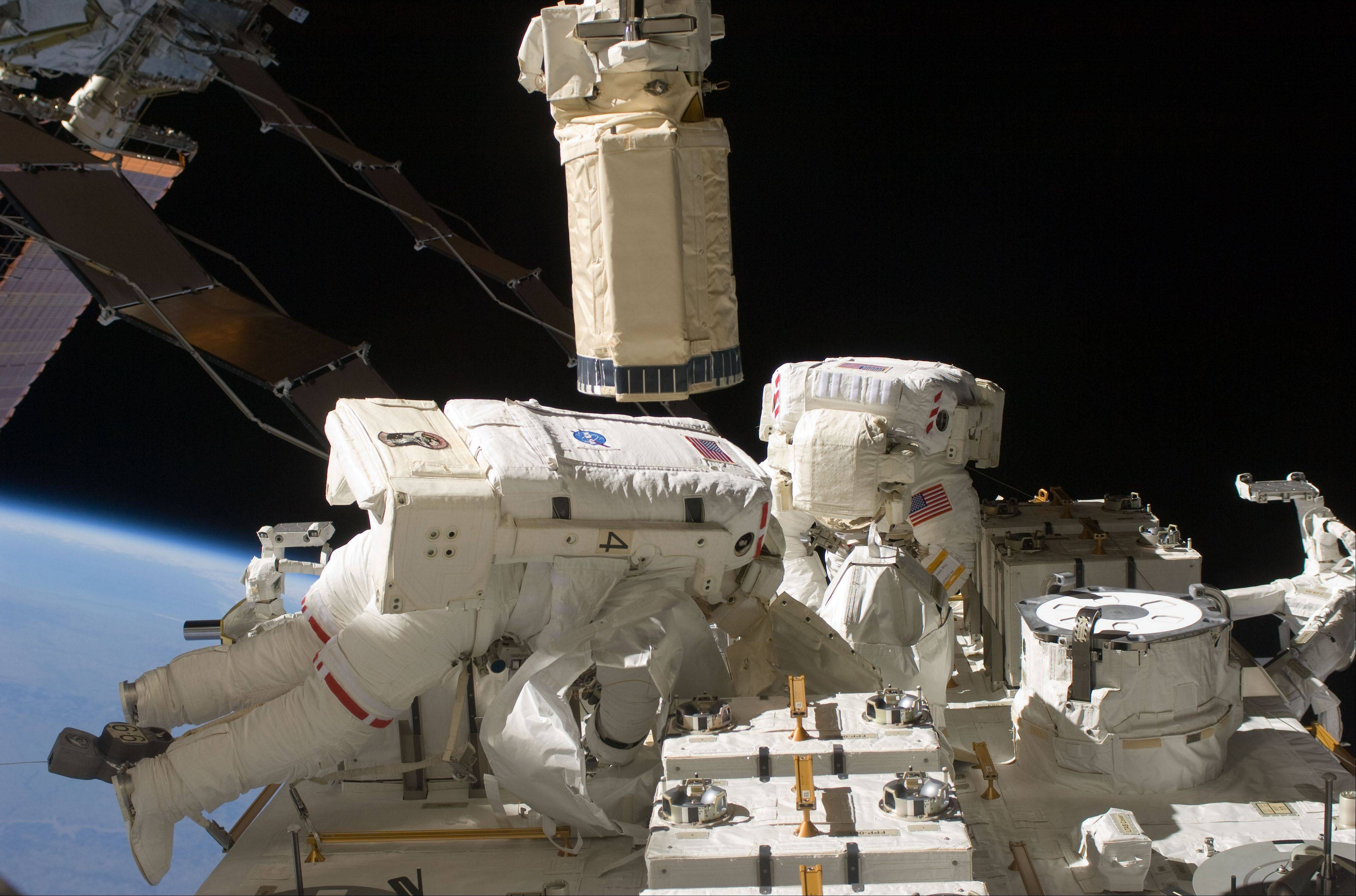 Associated Press/July 27, 2009 Astronauts Tom Marshburn, left, and Christopher Cassidy participate in a spacewalk for maintenance tasks. On Friday the two astronauts are preparing for a possible impromptu spacewalk to work on a leaking ammonia coolant line.