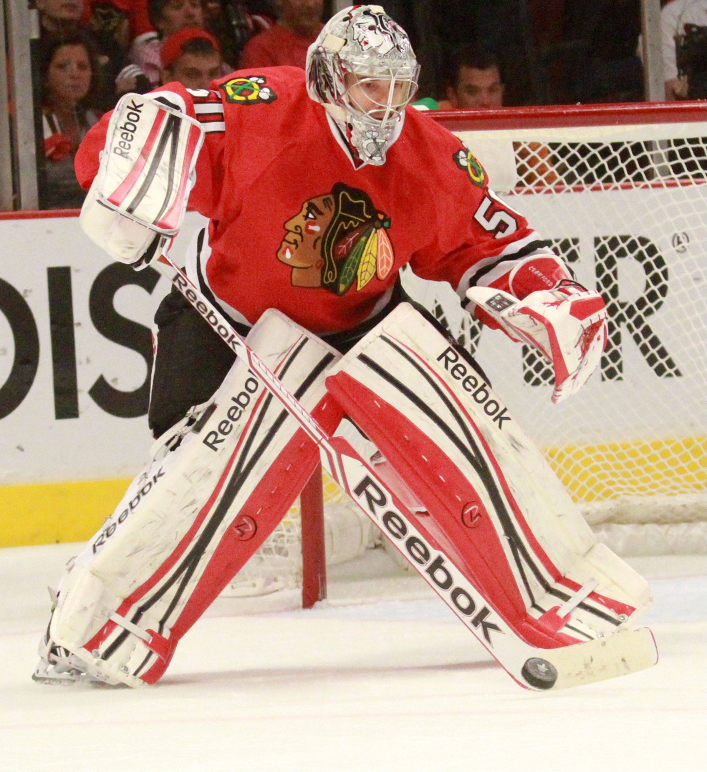Goalie Corey Crawford blocks a shot again in the Blackhawks� 5-1 win against the Minnesota Wild. The win made the series the first playoff series Crawford has won, and the first for the Hawks since their 2010 Stanley Cup win.