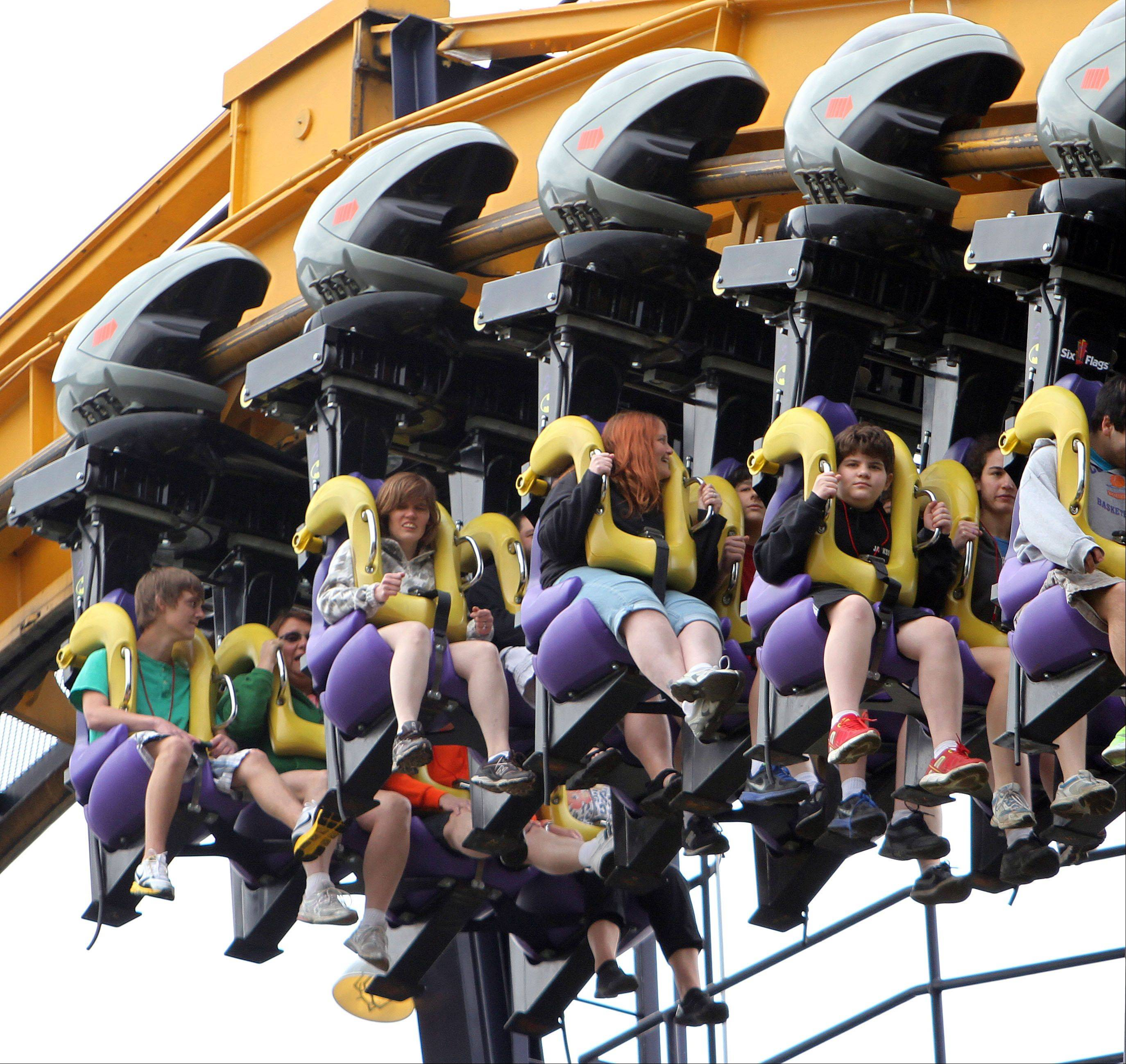 Riders try sitting backward on Batman: The Ride on Thursday at Six Flags Great America in Gurnee.