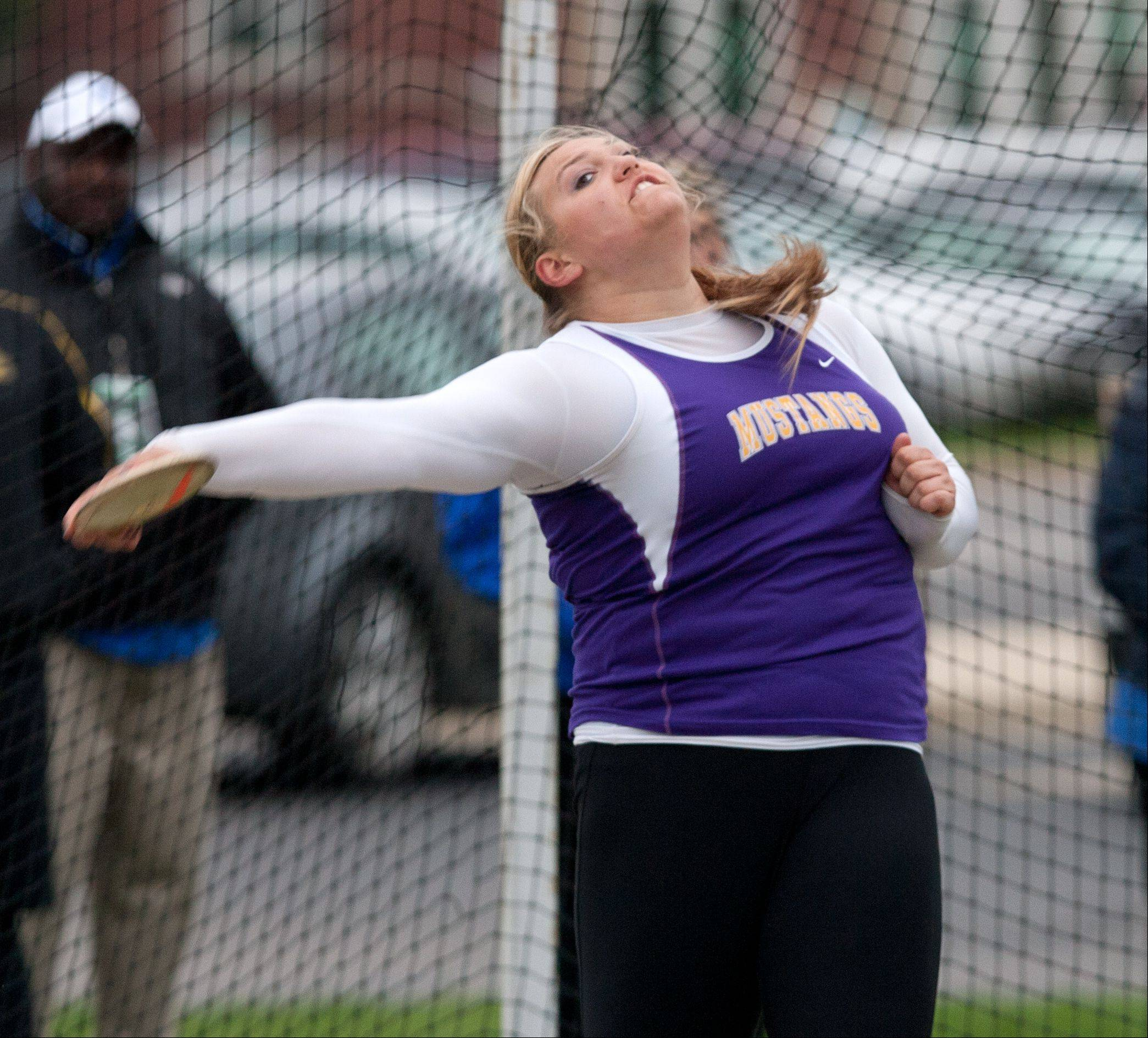 Rolling Meadow�s Morgan Keller throws to a sectional victory in the discus Friday at York.