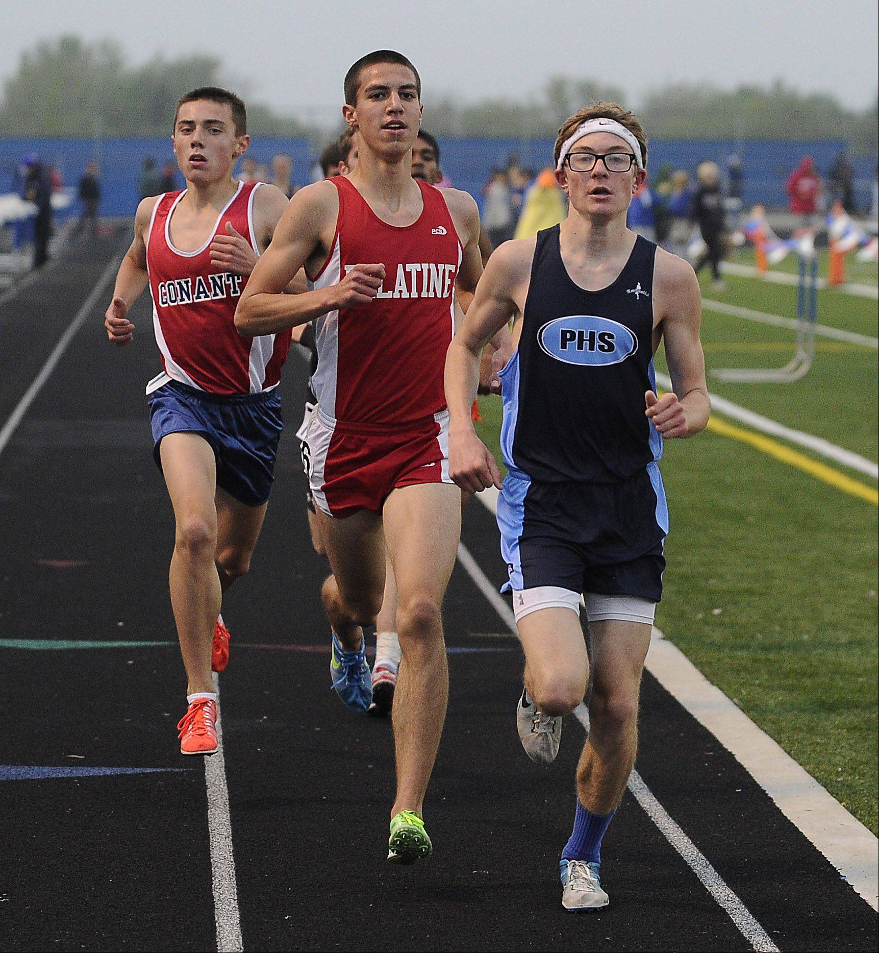 Quentin Schaeffer of Prospect wins the 3,200-meter run at the Mid-Suburban League meet at Hoffman Estates on Friday.