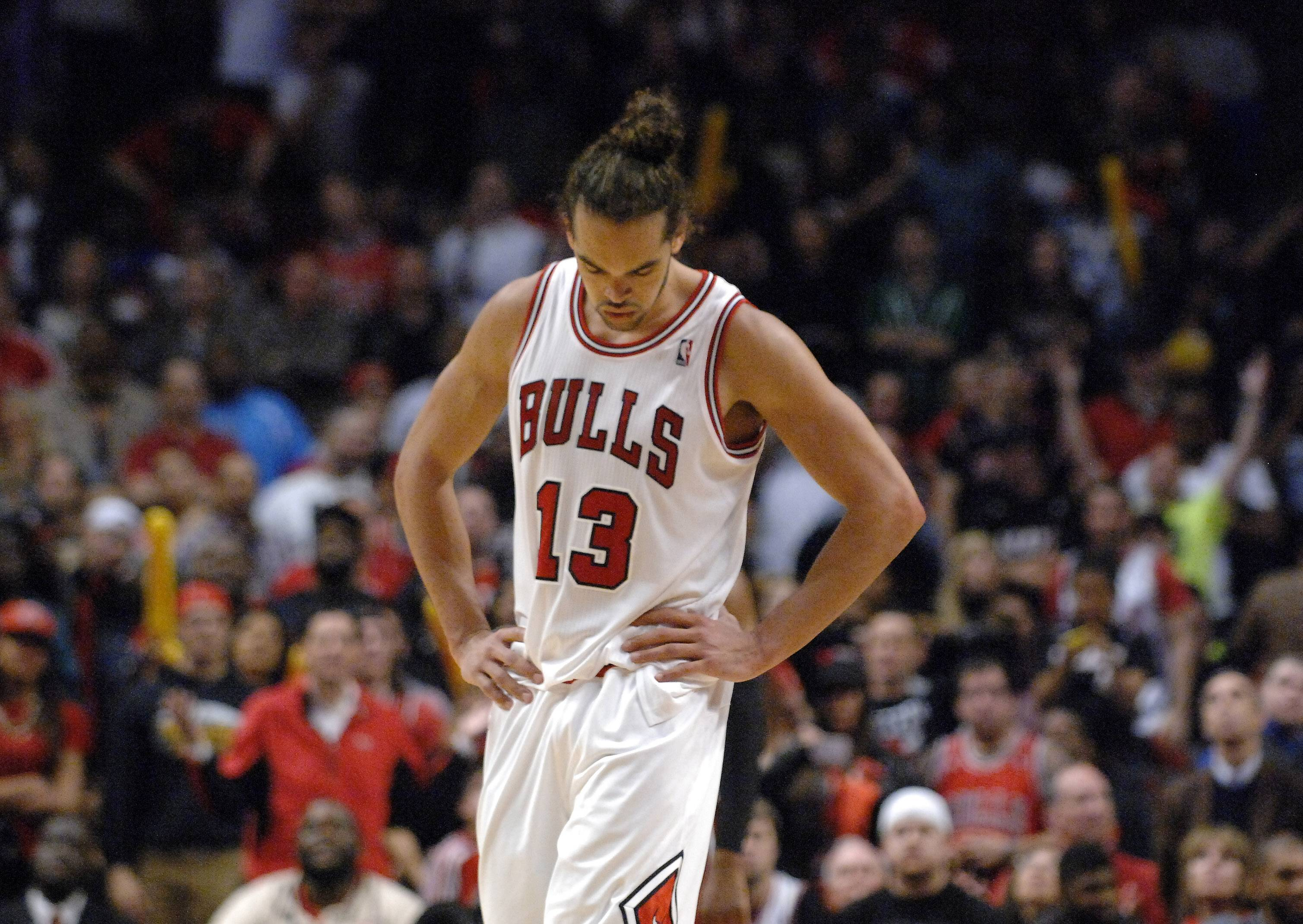 Chicago Bulls center Joakim Noah (13) walks to the bench after fouling out during Game 3 of an NBA basketball playoffs Eastern Conference semifinal on Friday, May 10, 2013, in Chicago. The heat won 104-94.
