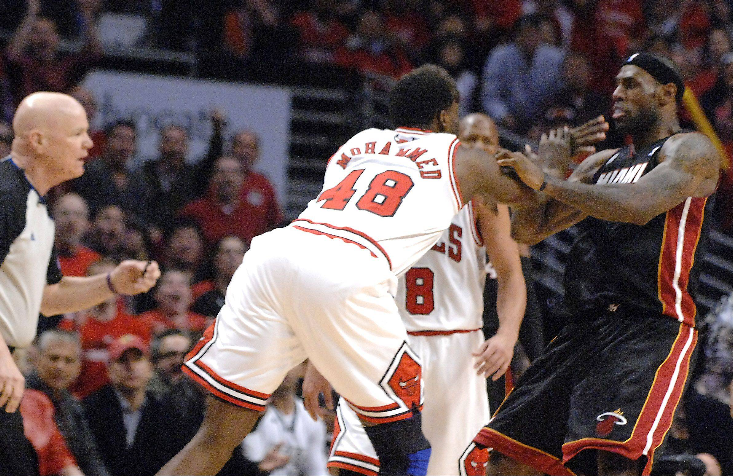 Bulls center Nazr Mohammed (48) shoves Miami Heat small forward LeBron James (6) and gets ejected during game 3 of the NBA Eastern Conference semifinals at the United Center in Chicago Friday.