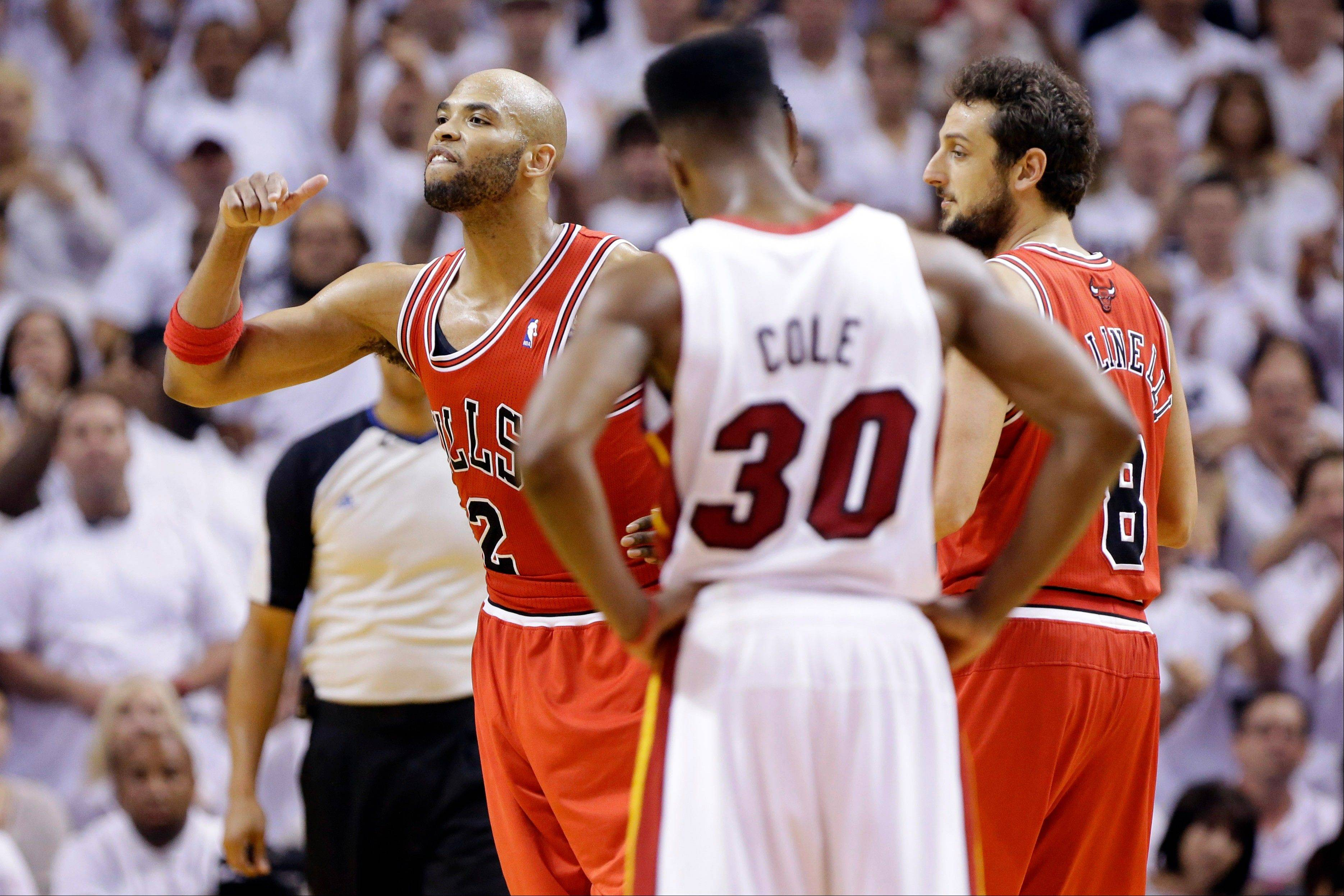 Bulls forward Taj Gibson, left, got emotional after he was ejected in Game 2 of the playoff series against the Miami Heat. Gibson was fined $25,000 for his outburst toward an official.