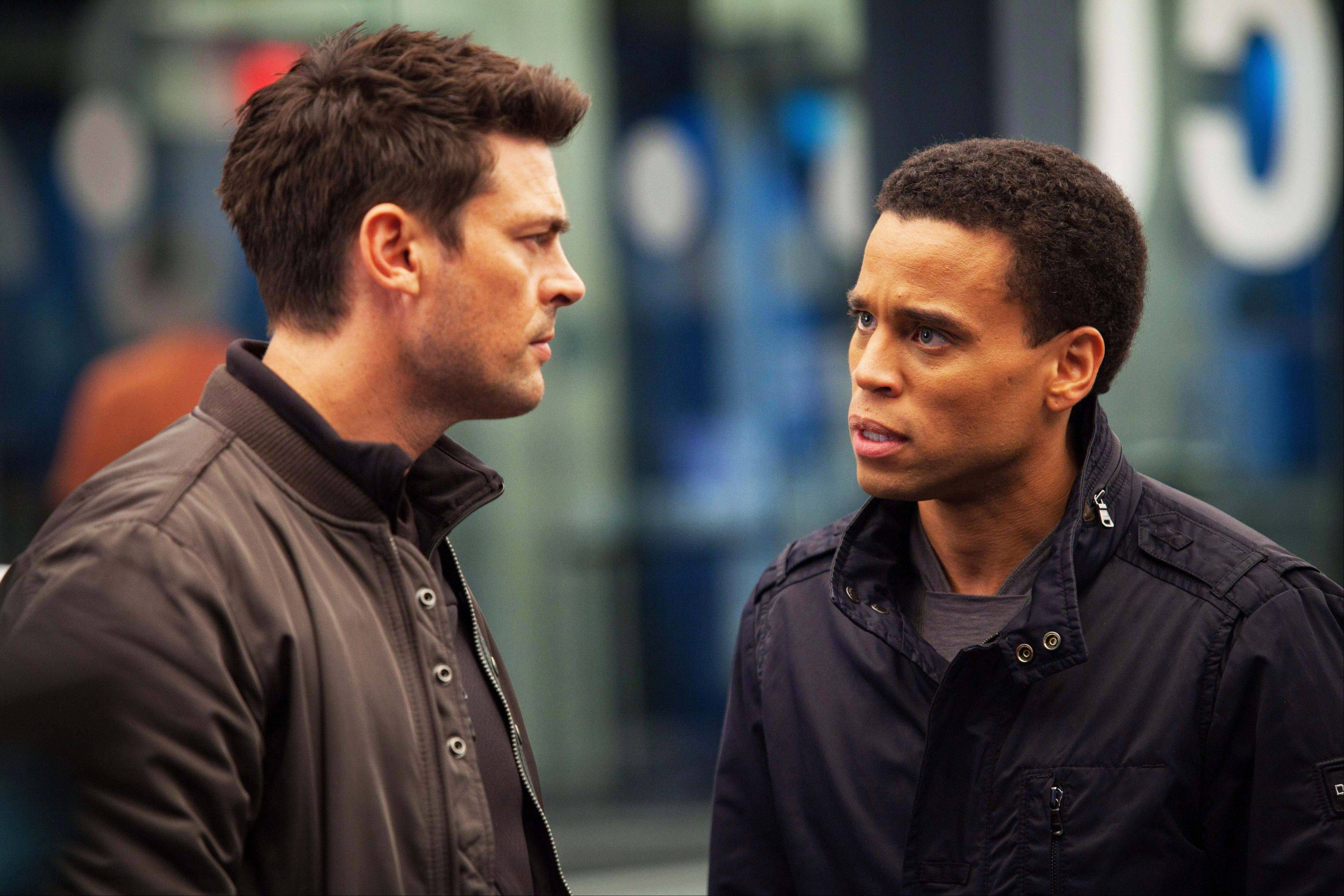 "Karl Urban, left, as John Kennex and Michael Ealy as Dorian partner to fight crime in the year 2048 in the new FOX drama, ""Almost Human,"" premiering this fall."