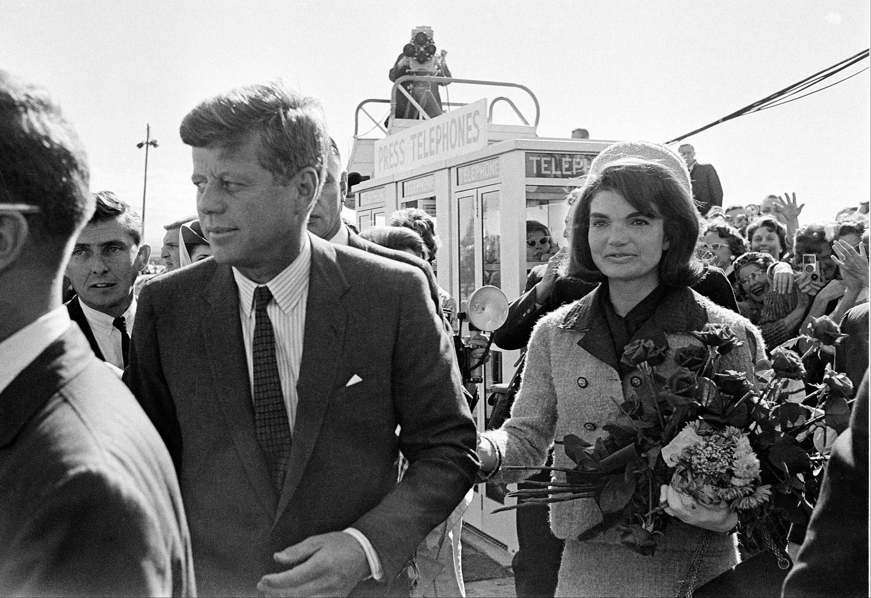 "President John F. Kennedy and his wife Jacqueline Kennedy upon their arrival at Dallas Airport shortly before President Kennedy was assassinated. PBS says its fall schedule will include a variety of specials marking President John F. Kennedy's death 50 years ago. In the weeks leading up to the milestone anniversary of his Nov. 22, 1963, slaying in Dallas, PBS said it will air ""JFK,"" a four-hour ""American Experience"" special."