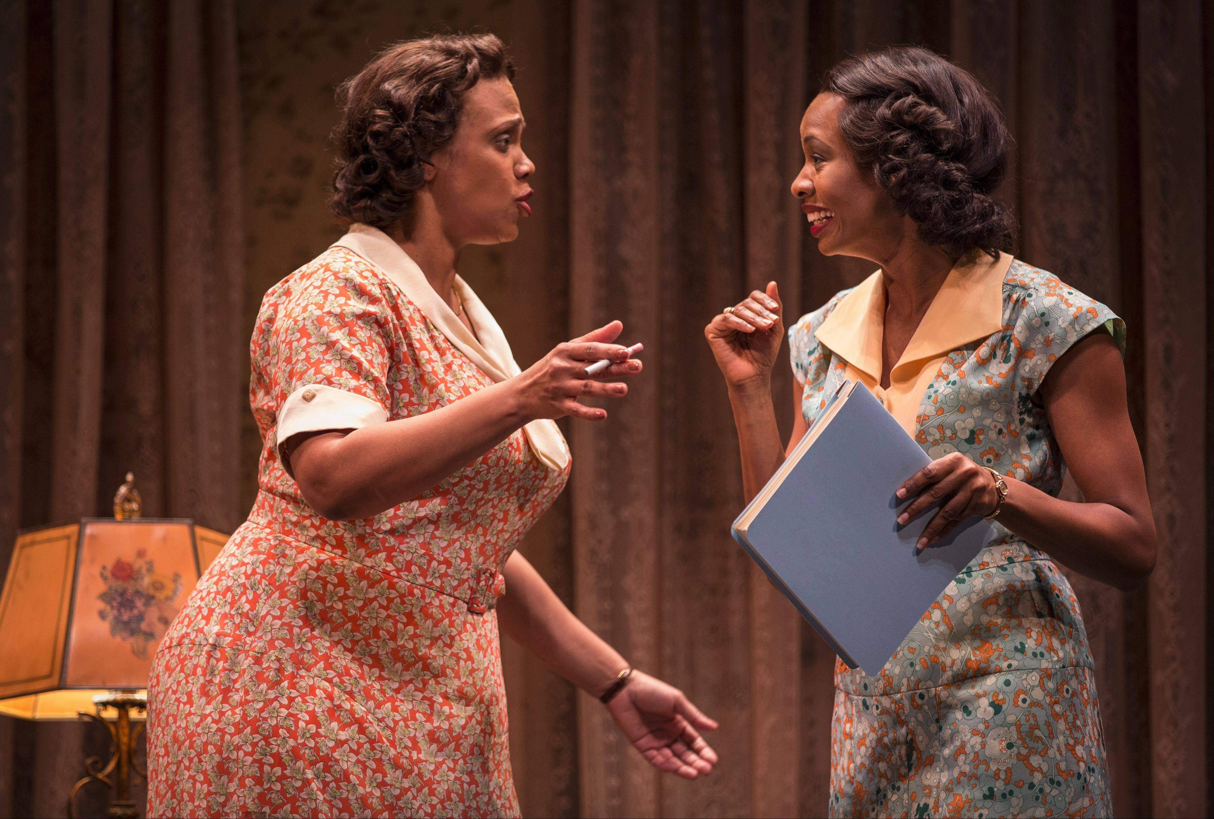 "Lottie (TaRon Patton, left) and Vera (Tamberla Perry) jump at the chance to act in a film where the slaves have lines in Lynn Nottage's ""By the Way, Meet Vera Stark"" in a Chicago-area premiere at Goodman Theatre."