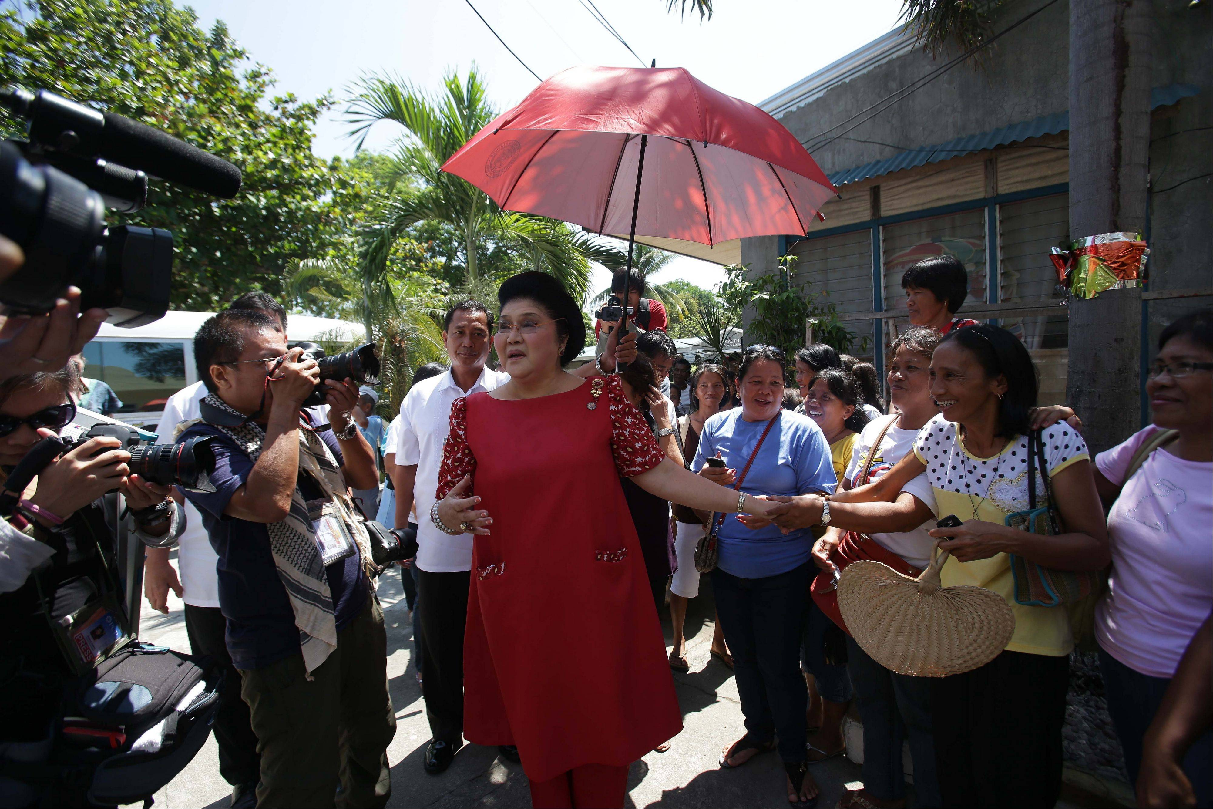 Former Philippine First Lady Imelda Marcos, center, greets supporters last Sunday during an electoral campaign in Ilocos Norte province, northern Philippines. Twenty-seven years after her dictator husband was ousted by a public revolt, Imelda Marcos has emerged as the Philippines� ultimate political survivor.