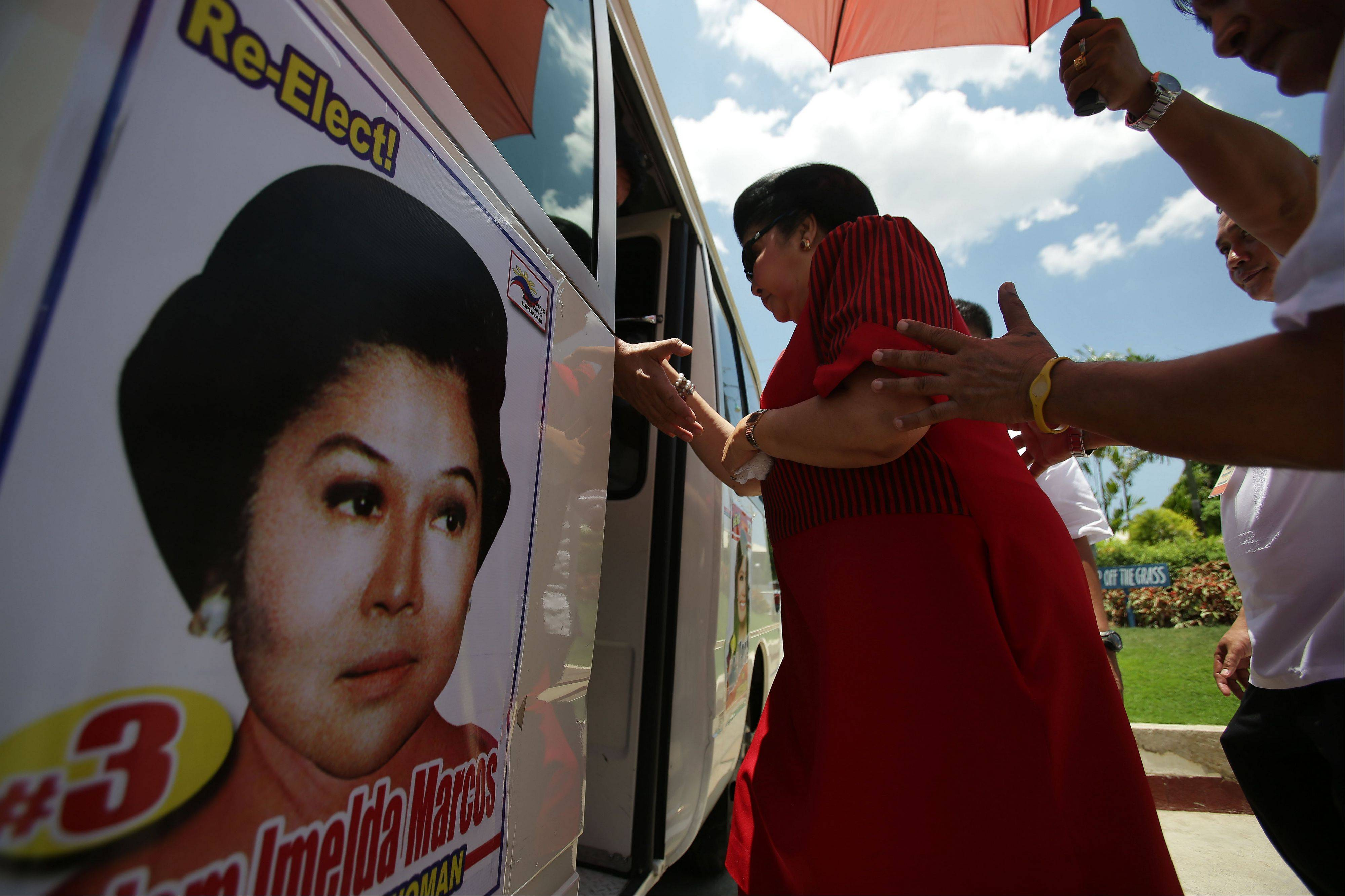 Marcos enters her van last Sunday during an electoral campaign in Ilocos Norte province, northern Philippines.