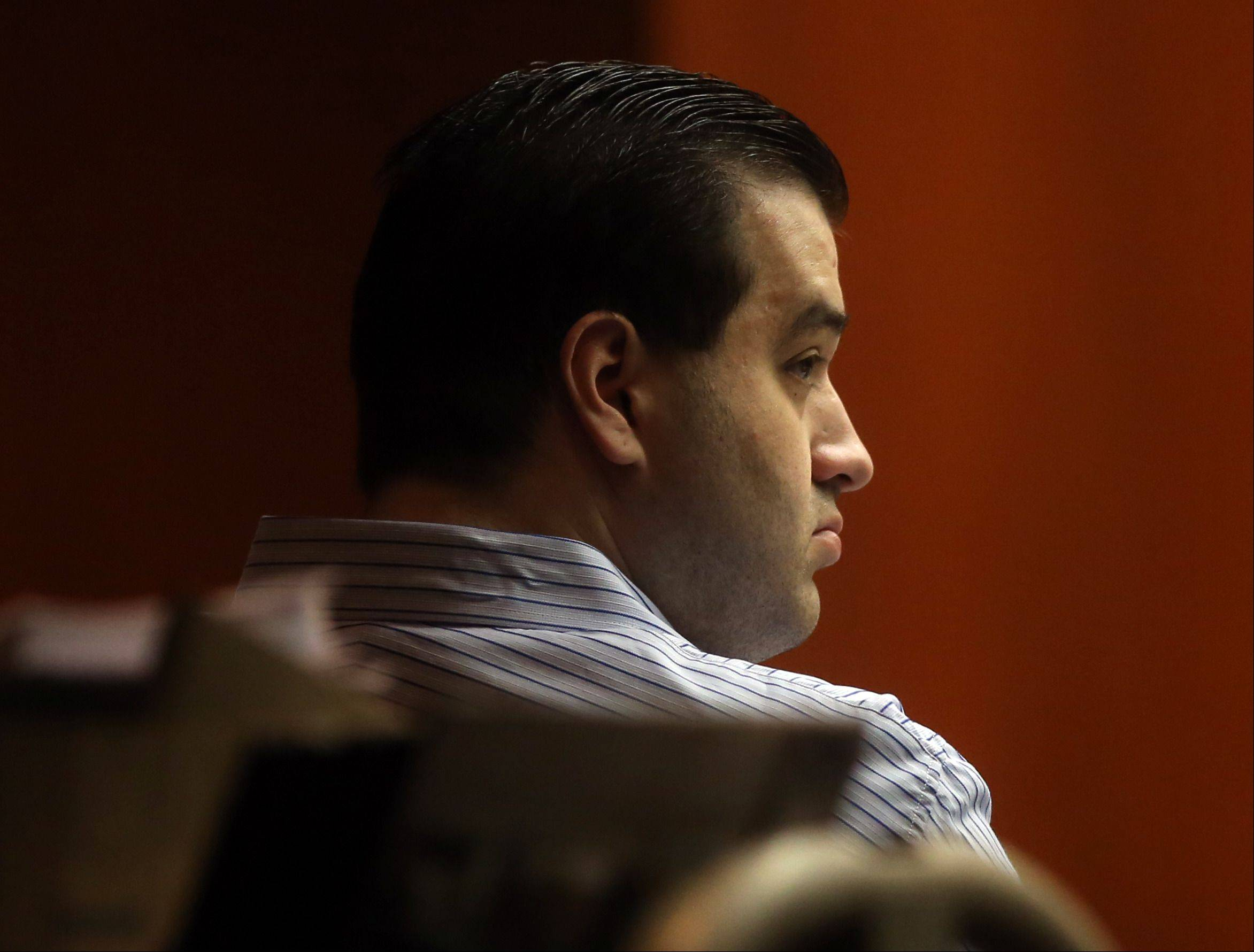 Johnny Borizov listens to testimony during his trial at the DuPage County Courthouse in Wheaton on Friday.