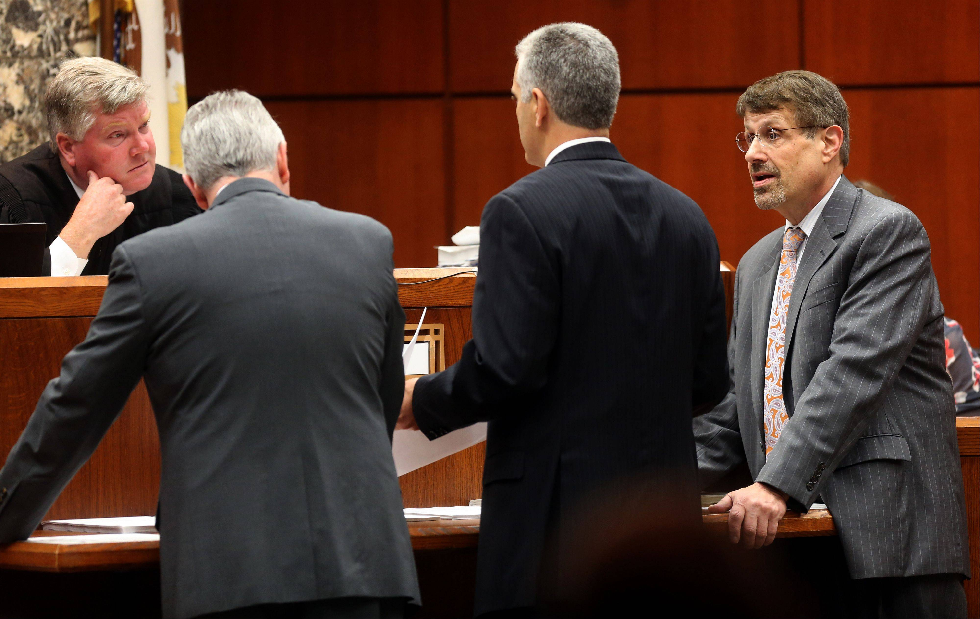 DuPage County Circuit Court Judge Daniel P. Guerin, left, speaks with DuPage County Assistant State's Attorney Joe Ruggiero, center, and defense attorney Richard Kling during the trial of Johnny Borizov, at the DuPage County Courthouse in Wheaton.