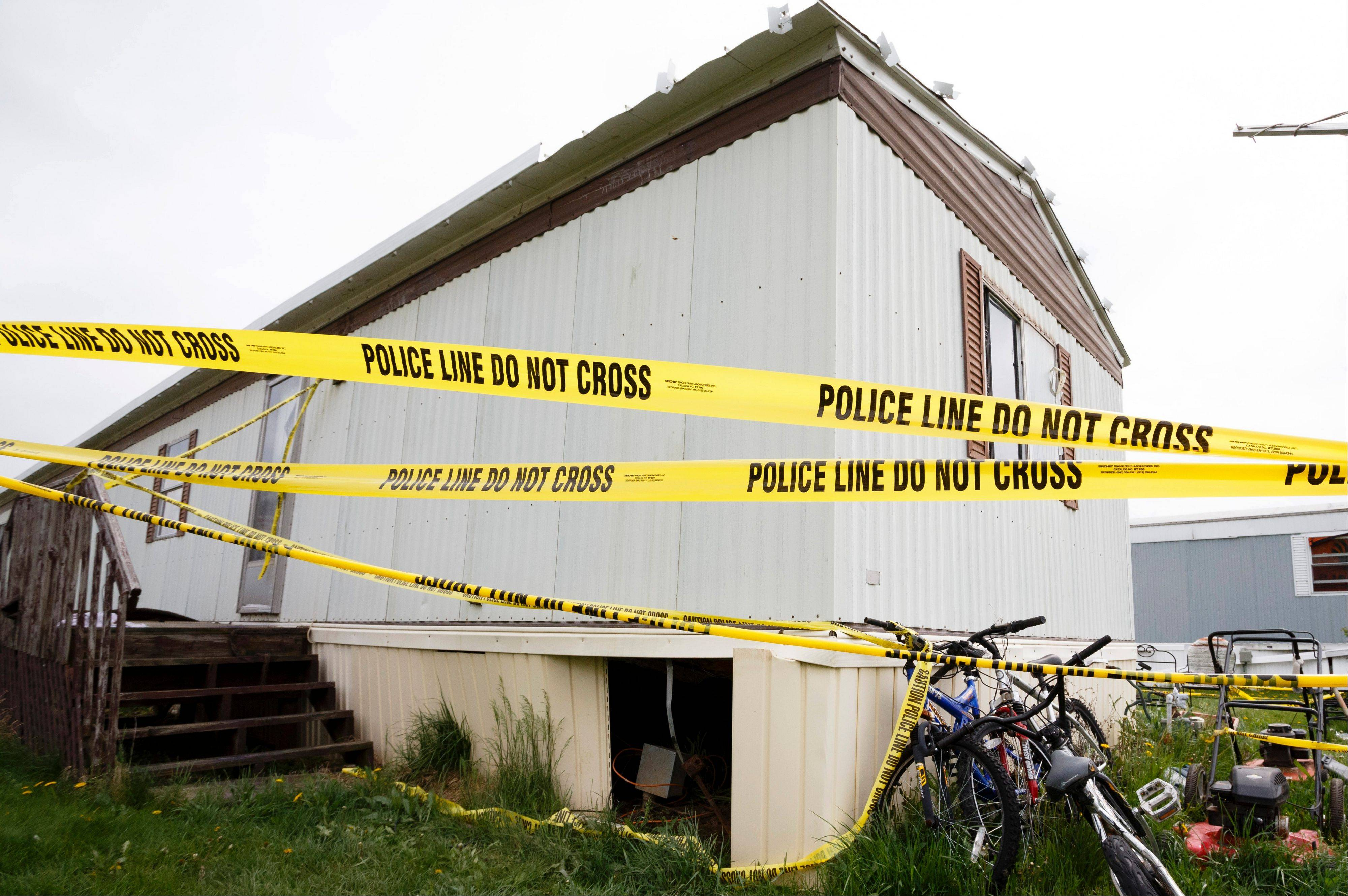 Police tape closes off the home Friday of Blake and Blaine Romes in Ottawa, Ohio.