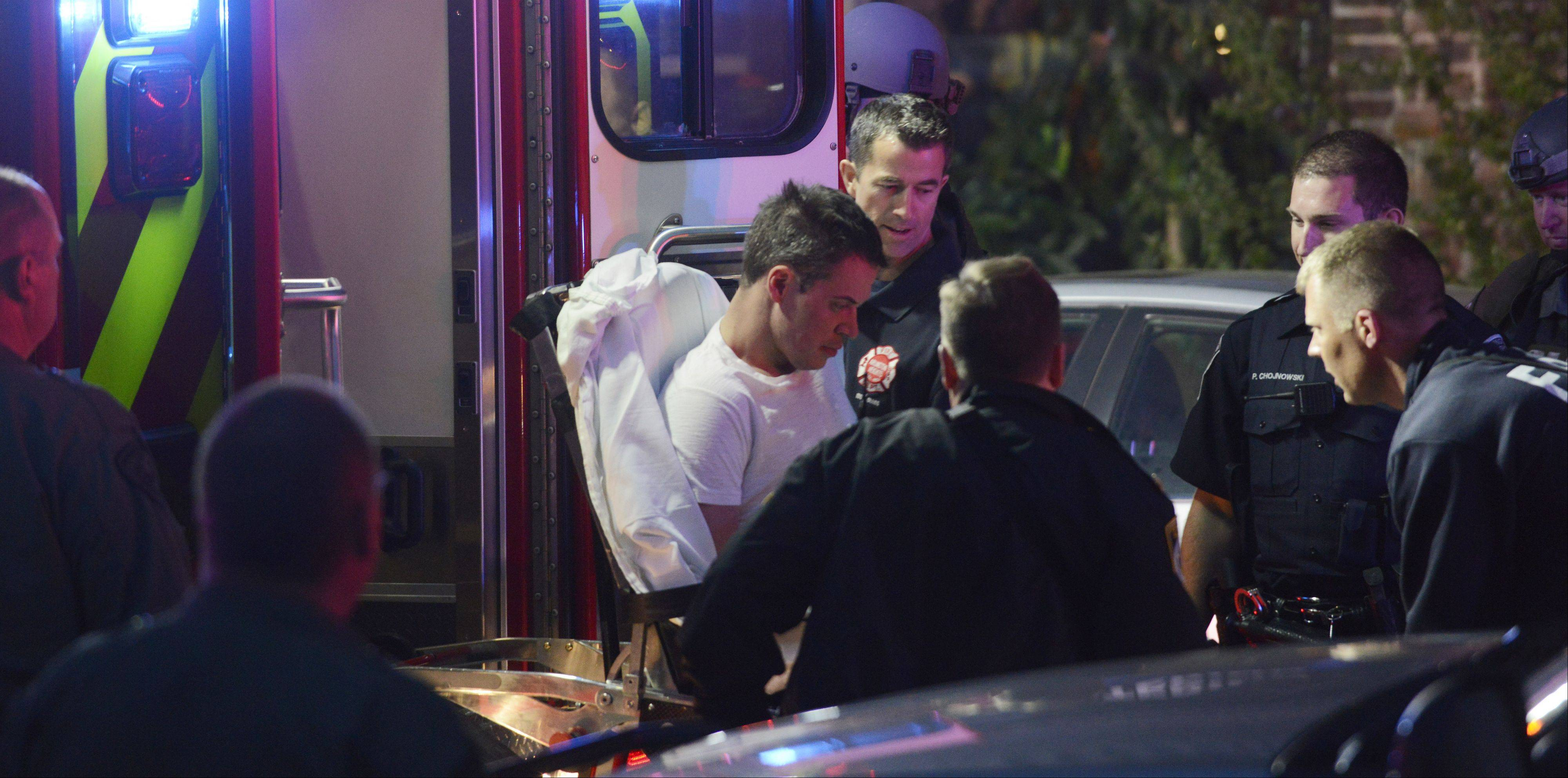 Jeffrey Sterner is loaded into the back of an ambulance to be taken to Northwest Community Hospital for evaluation at the conclusion of a May 4 police standoff in downtown Arlington Heights.