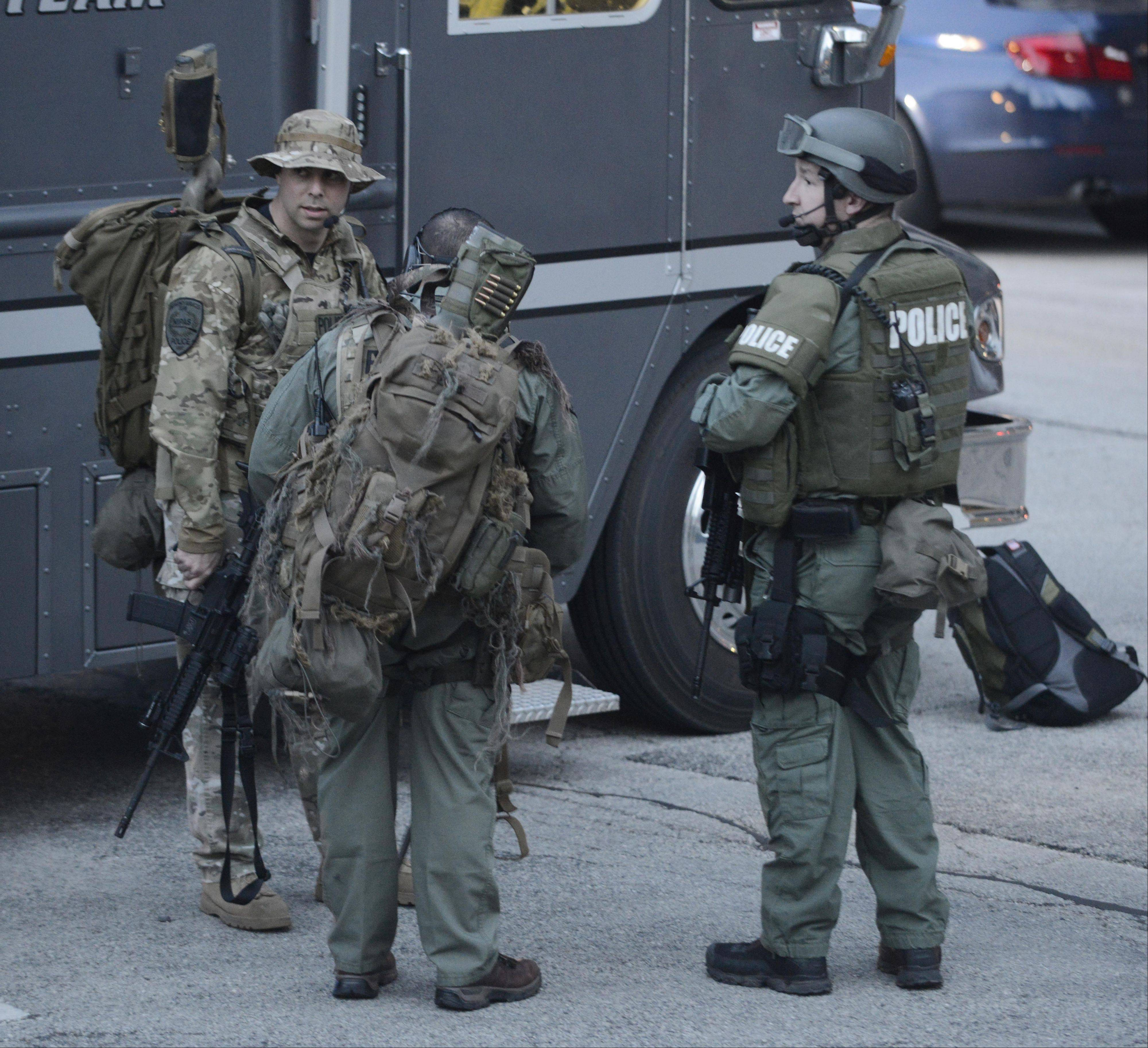 Heavily-armed officers gather at the conclusion of the May 4 police standoff in Arlington Heights.