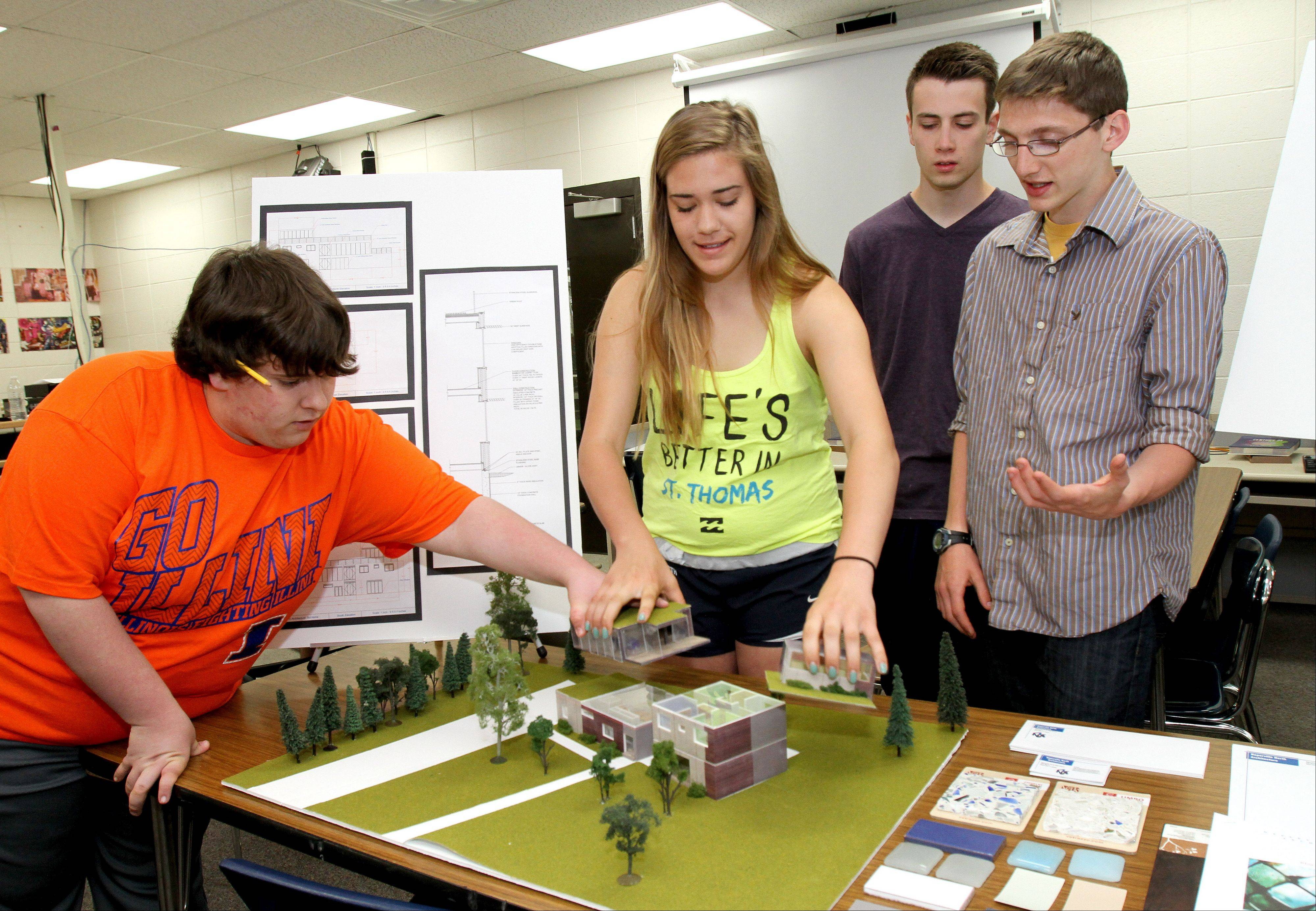 "Naperville North architecture students Chris Greco, Lauren Hanson, Jonathan Quinn and Evan Harrison describe the features of their ""green"" building design, which won first place in the state in the 2013 Mock Firms competition."